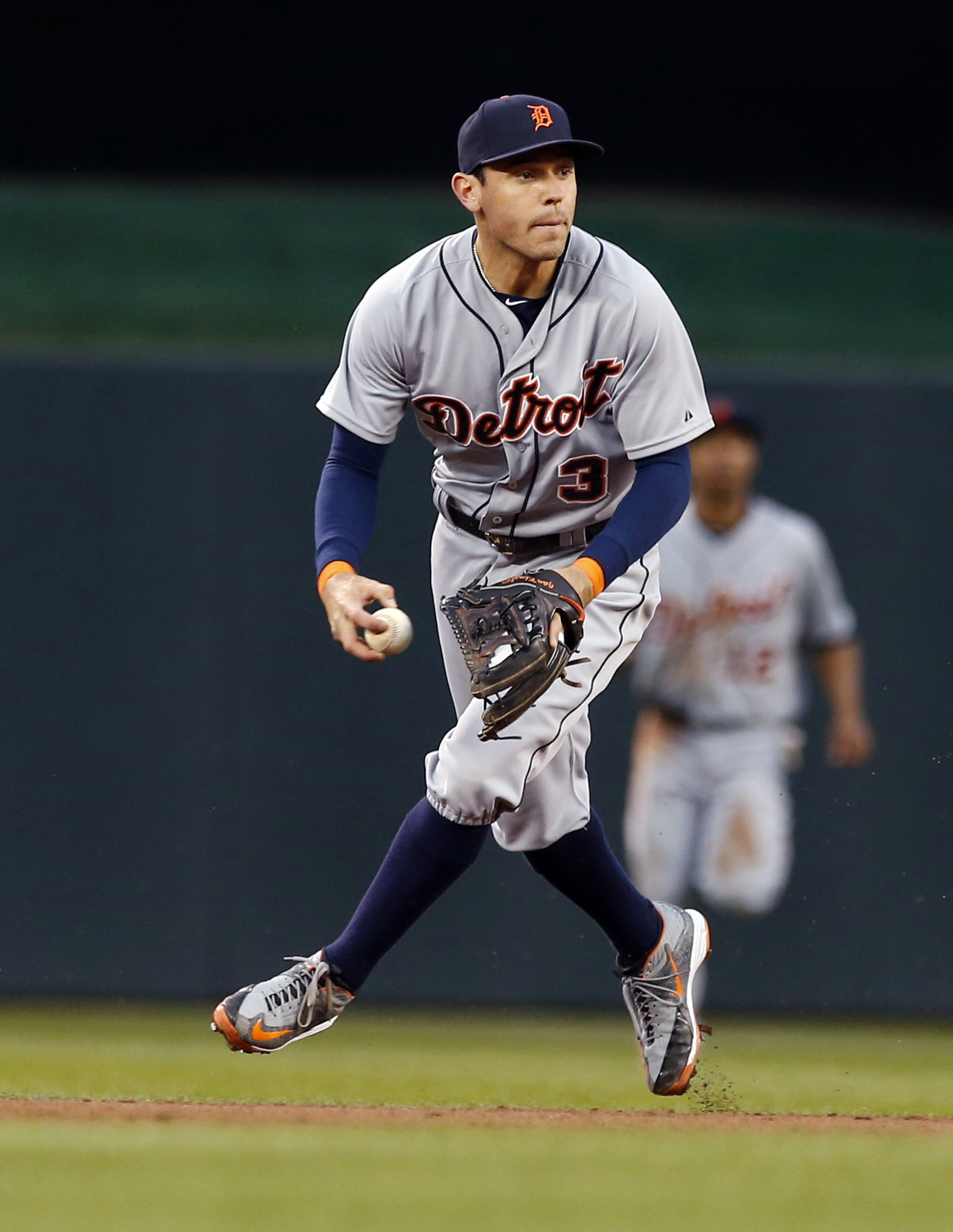 Detroit Tigers second baseman Ian Kinsler fields a grounder by Minnesota Twins' Torii Hunter before throwing him out in the third  inning of a baseball game, Tuesday, April 28, 2015, in Minneapolis. (AP Photo/Jim Mone)
