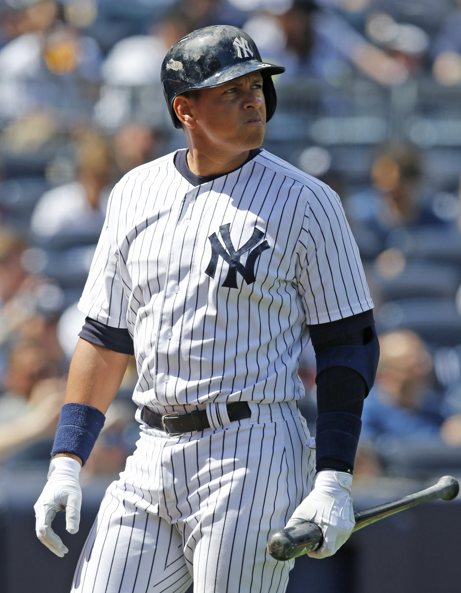 New York Yankees designated hitter Alex Rodriguez reacts walking back to the dugout after striking out in the fourth inning of a baseball game against the Tampa Bay Rays at Yankee Stadium in New York, Wednesday, April 29, 2015.  (AP Photo/Kathy Willens)