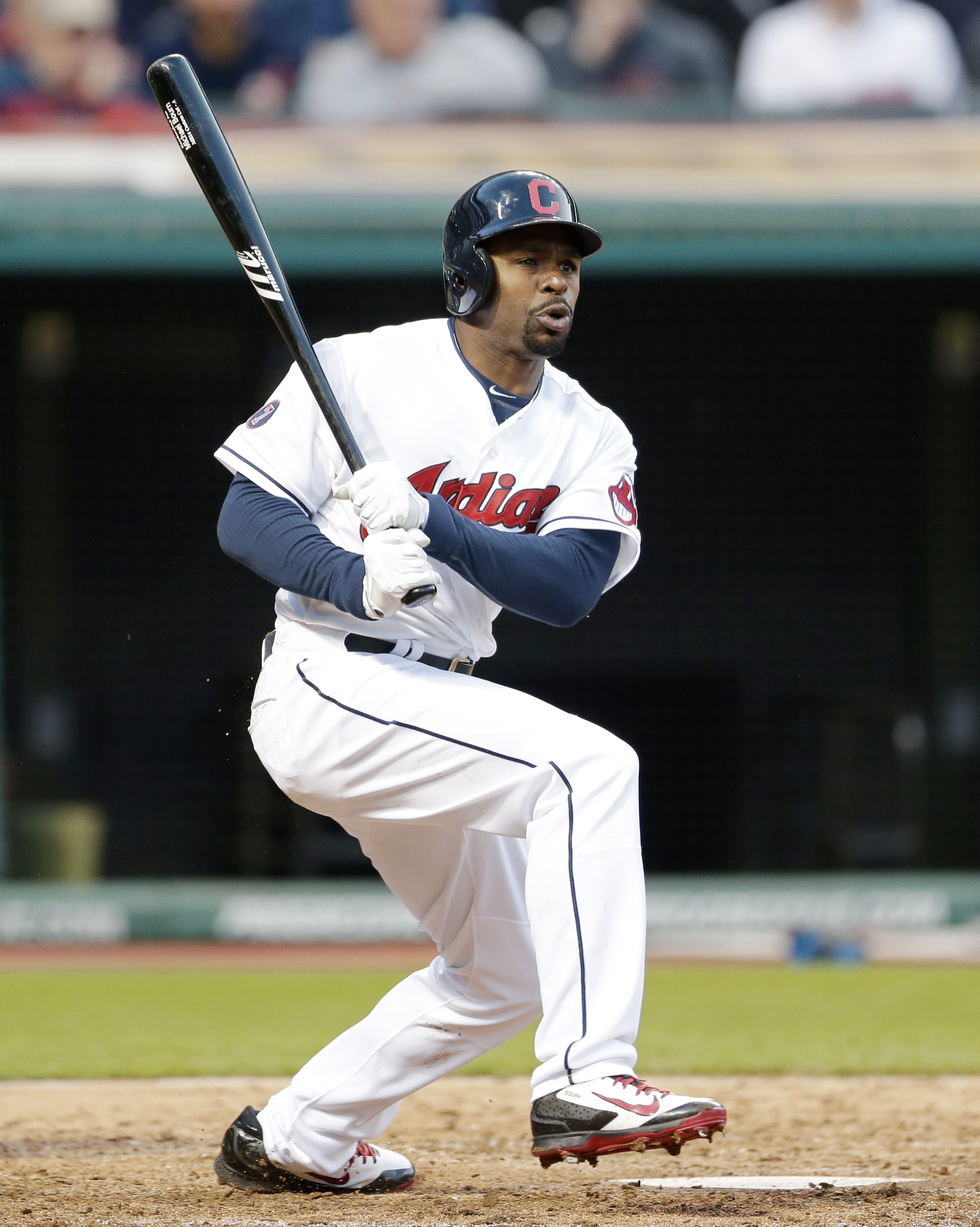 Cleveland Indians' Michael Bourn hits an RBI-double off Kansas City Royals relief pitcher Franklin Morales in the sixth inning of a baseball game, Wednesday, April 29, 2015, in Cleveland. Roberto Perez scored on the play. (AP Photo/Tony Dejak)