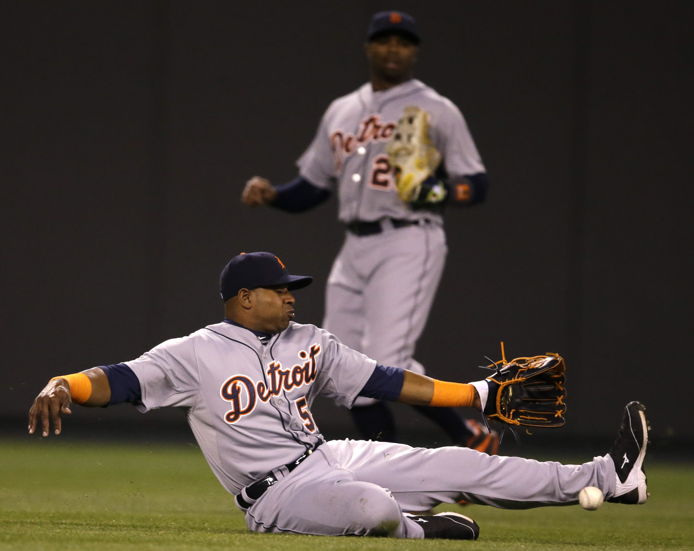 Detroit Tigers left fielder Yoenis Cespedes (52) misses a fly ball hit by Kansas City Royals' Omar Infante during the seventh inning of a baseball game at Kauffman Stadium in Kansas City, Mo., Thursday, April 30, 2015. Infante singled on the play. Detroit