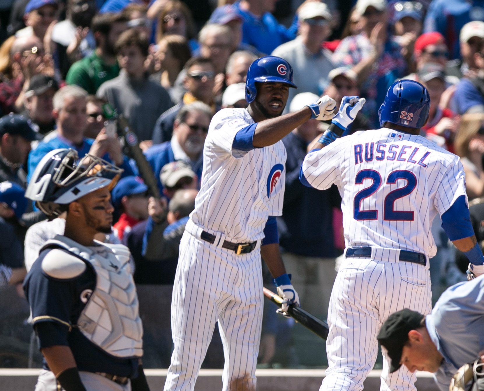 Chicago Cubs Addison Russell, right, is congratulated by Ricky Fowler after hitting his first major league home run in the third inning of a baseball game against the Milwaukee Brewers, Friday May 1, 2015, in Chicago. (AP Photo/Charles Cherney)