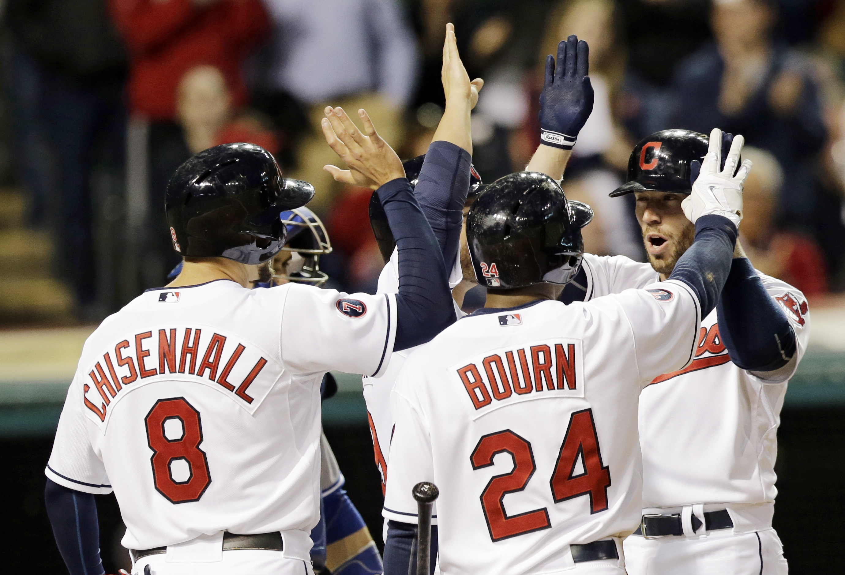 Cleveland Indians' Brett Hayes, right, is congratulated by Lonnie Chisenhall, left to right, and Michael Bourn after Hayes hit a three-run home run off Toronto Blue Jays relief pitcher Andrew Albers in the fifth inning of a baseball game, Friday, May 1, 2