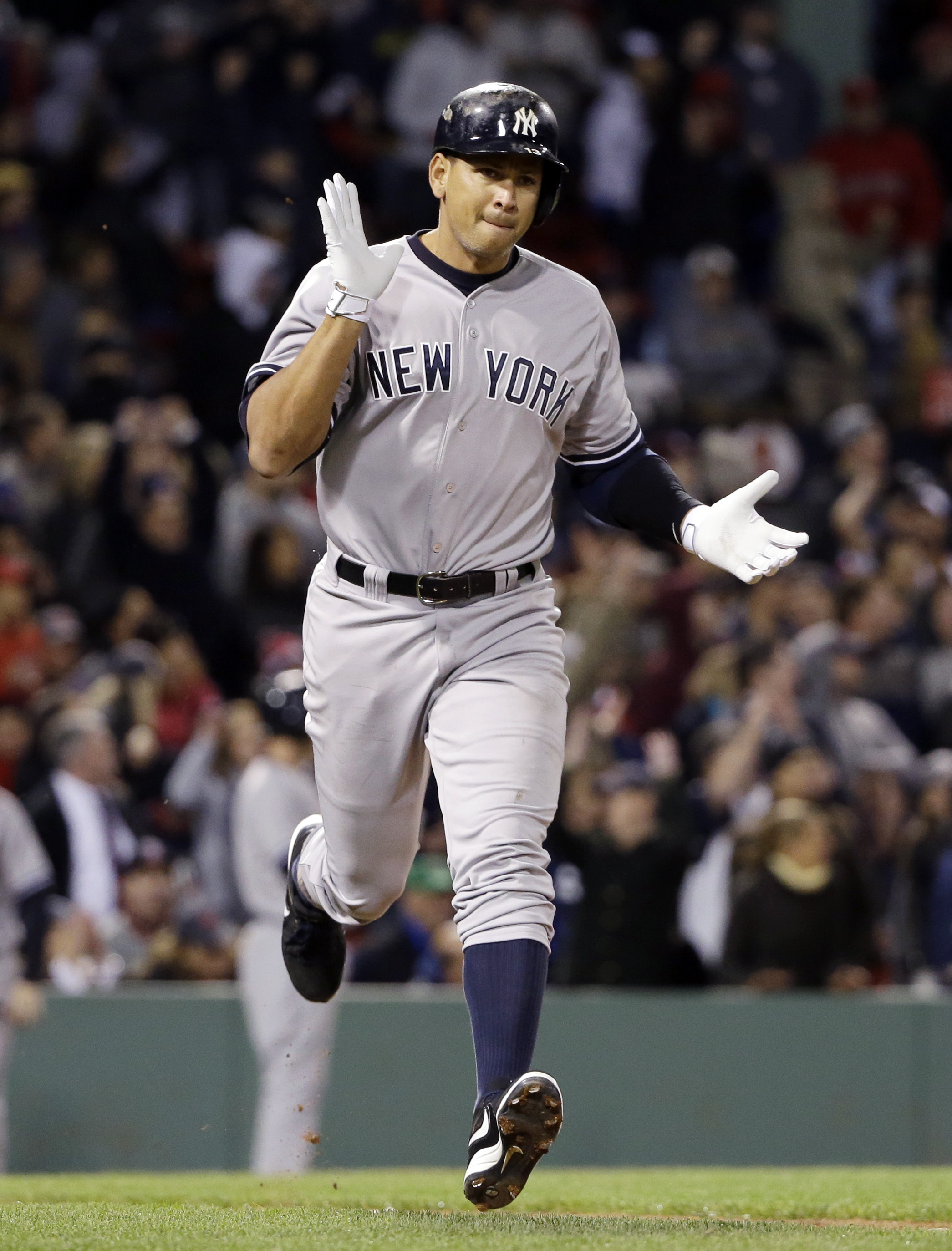 New York Yankees pinch hitter Alex Rodriguez runs to first after hitting a solo homer in the eighth inning of a baseball game against the Boston Red Sox at Fenway Park in Boston, Friday, May 1, 2015. Rodriguez has now tied slugger Willie Mays with 660 car