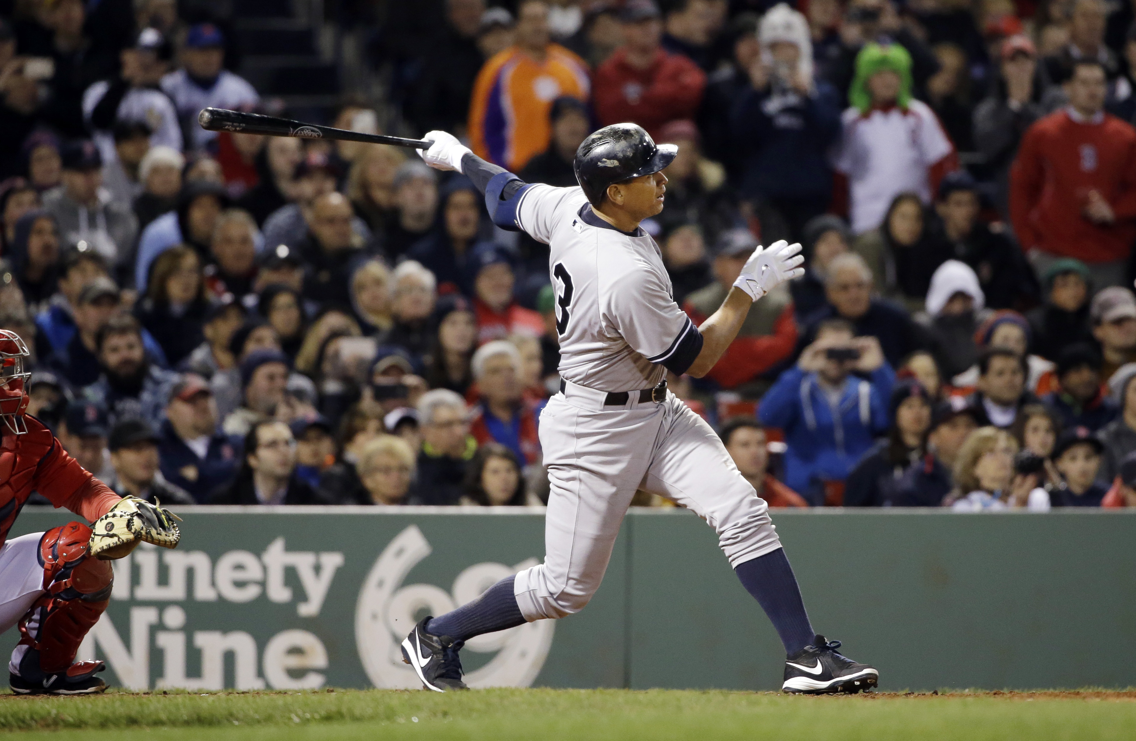 New York Yankees pinch hitter Alex Rodriguez hits a solo homer in the eighth inning of a baseball game against the Boston Red Sox at Fenway Park in Boston, Friday, May 1, 2015. Rodriguez has now tied slugger Willie Mays with 660 career home runs. (AP Phot