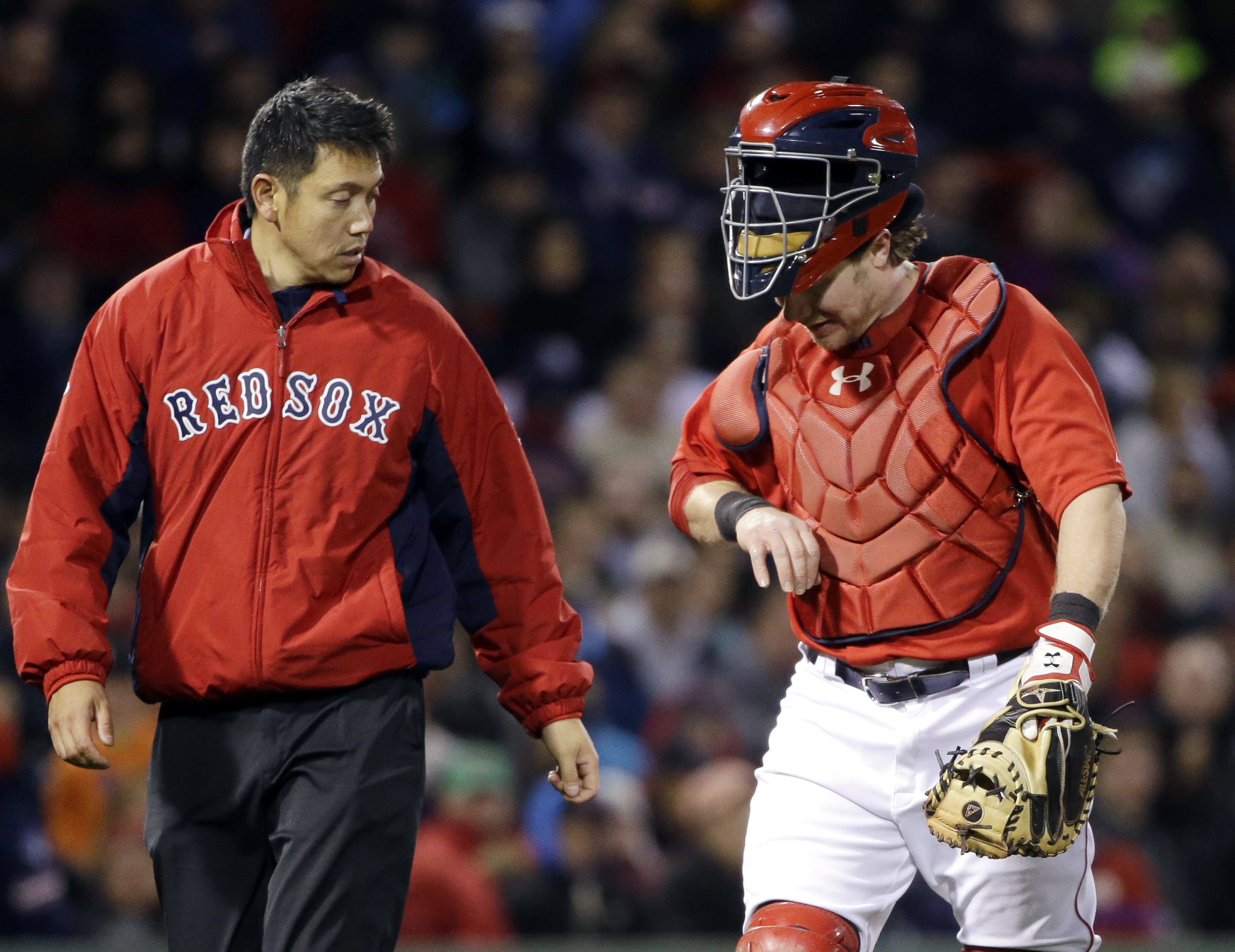Boston Red Sox catcher Ryan Hanigan looks at his hand as he leaves in the seventh inning of a baseball game at Fenway Park in Boston, Friday, May 1, 2015, after being hit by a pitch from reliever Tommy Layne which first hit New York Yankees batter Mark Te