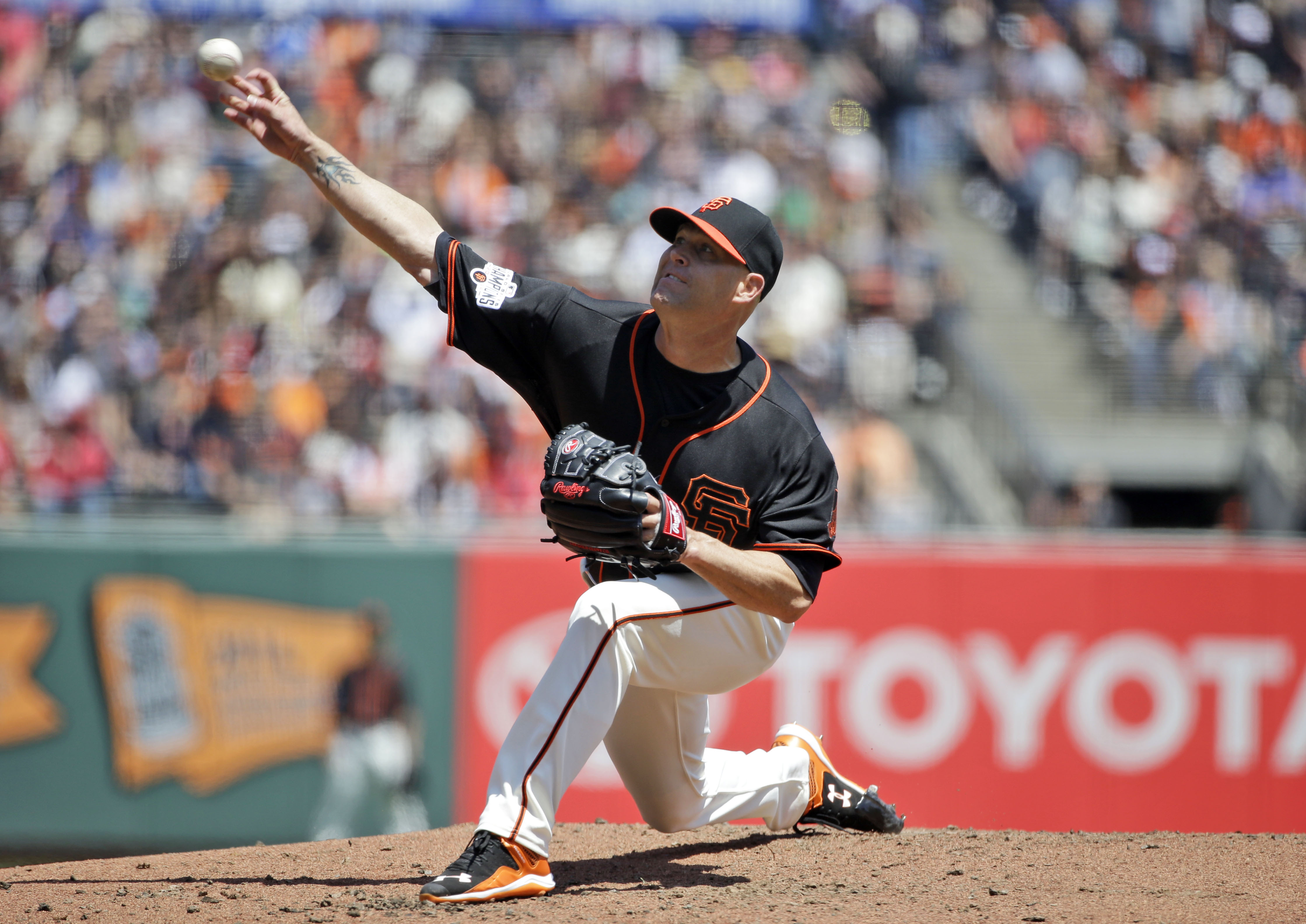 San Francisco Giants starting pitcher Tim Hudson throws to the Los Angeles Angels during the second inning of a baseball game on Saturday, May 2, 2015, in San Francisco. (AP Photo/Marcio Jose Sanchez)