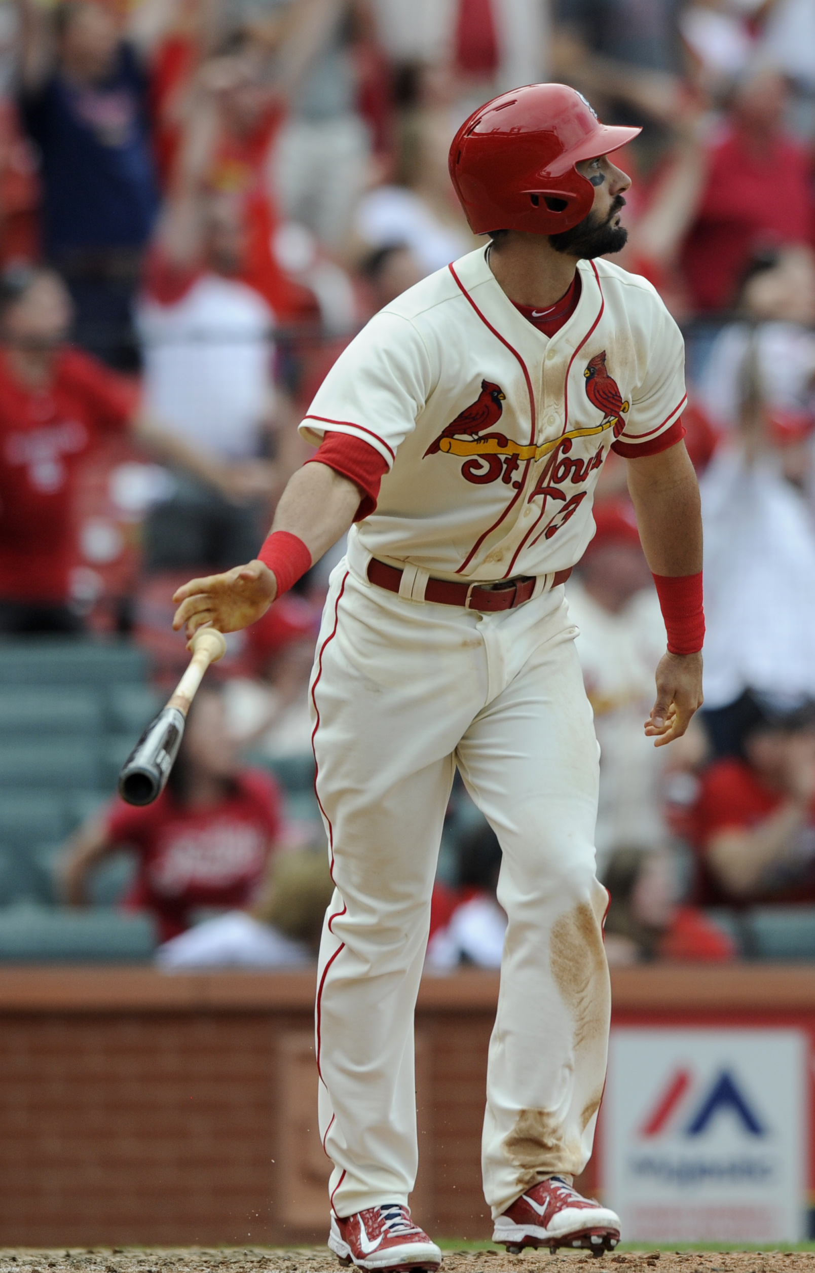 St. Louis Cardinals' Matt Carpenter watches his game-winning sacrifice fly to defeat the Pittsburgh Pirates 2-1 in the eleventh inning in a baseball game, Saturday, May 2, 2015, at Busch Stadium in St. Louis. (AP Photo/Bill Boyce)