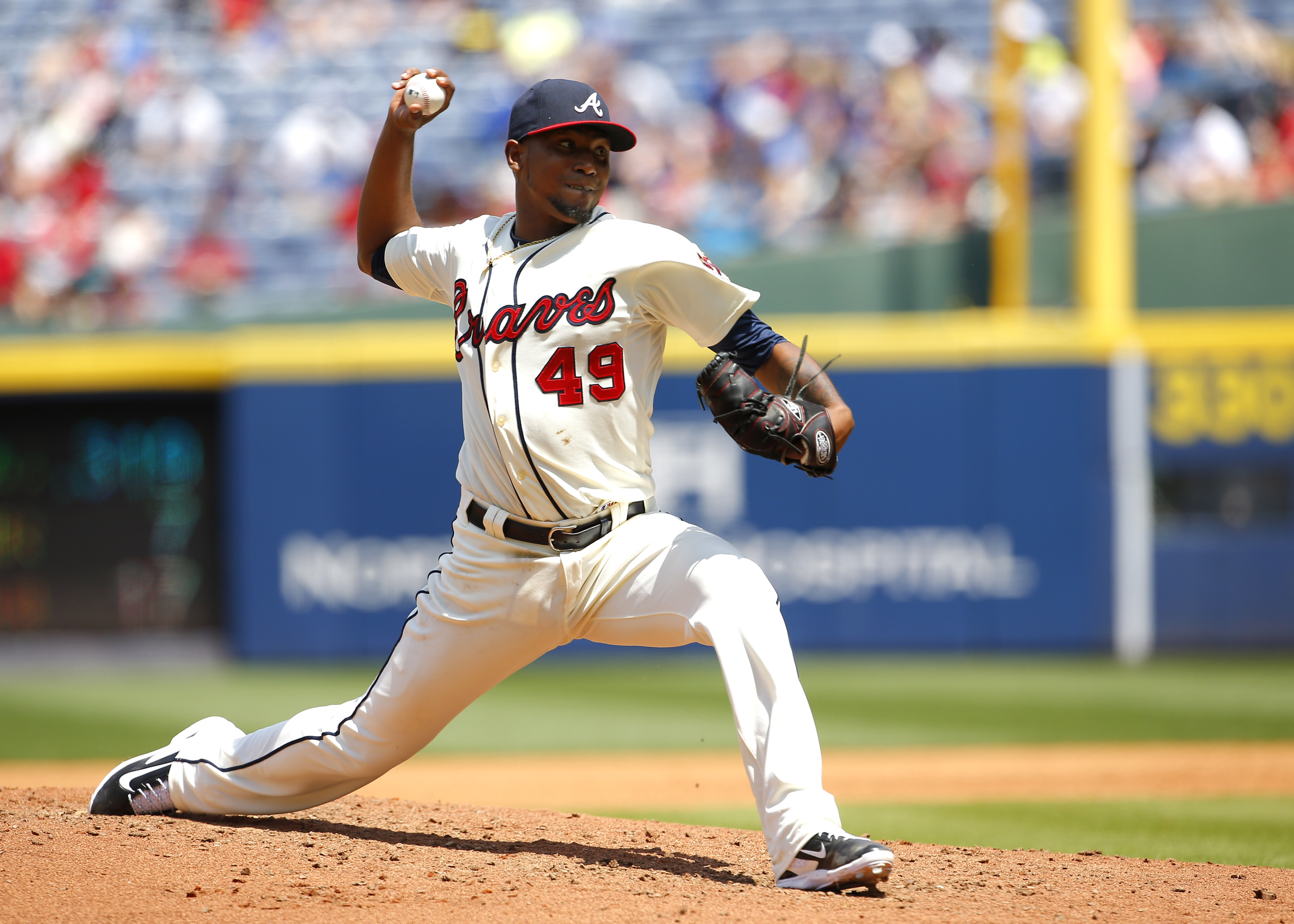 Atlanta Braves starting pitcher Julio Teheran (49) delivers in the fourth inning of a baseball game against the Cincinnati Reds, Sunday, May 3, 2015, in Atlanta. (AP Photo/Todd Kirkland)