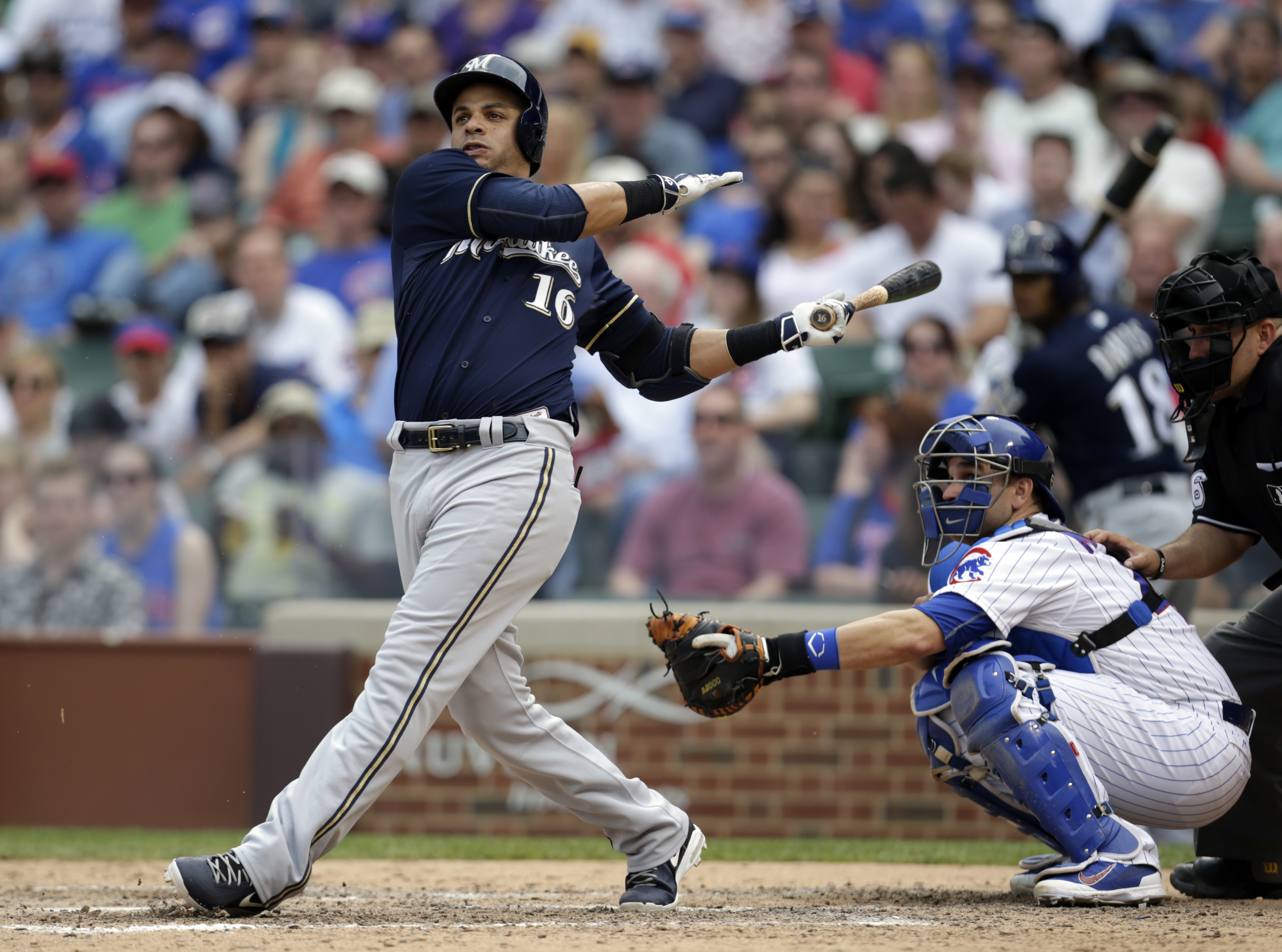 Milwaukee Brewers third baseman Aramis Ramirez (16) watches his two RBI single during the eighth inning of a baseball game as Chicago Cubs catcher Miguel Montero watches in Chicago, on Sunday, May 3, 2015. The Brewers won the game 5-3. (AP Photo/Jeff Hayn