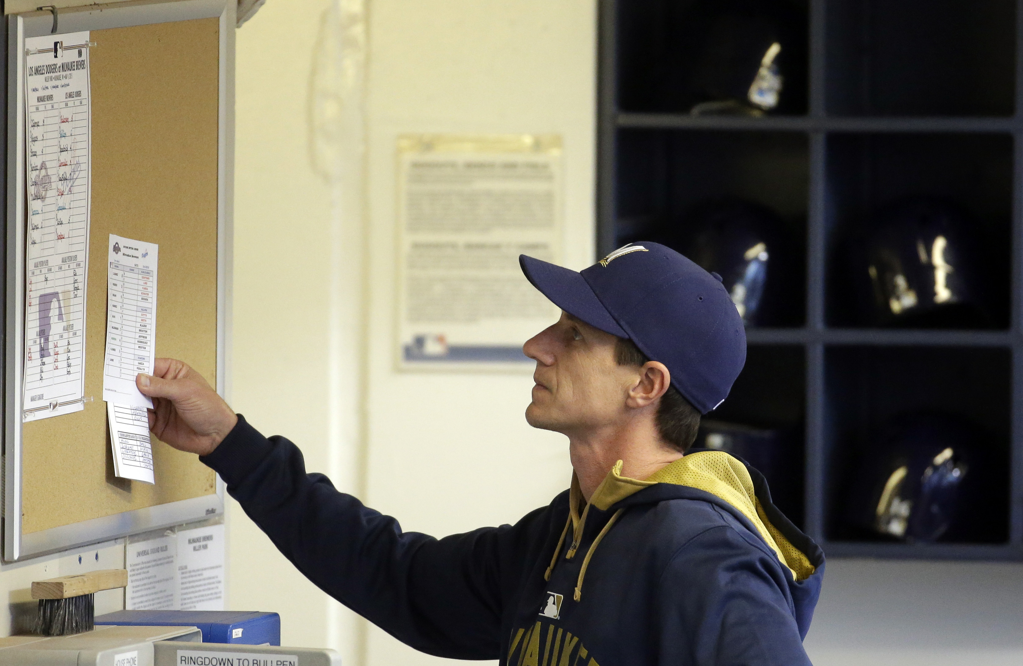 Milwaukee Brewers new manager Craig Counsell looks over his starting lineup before a baseball game against the Los Angeles Dodgers Monday, May 4, 2015, in Milwaukee. (AP Photo/Morry Gash)