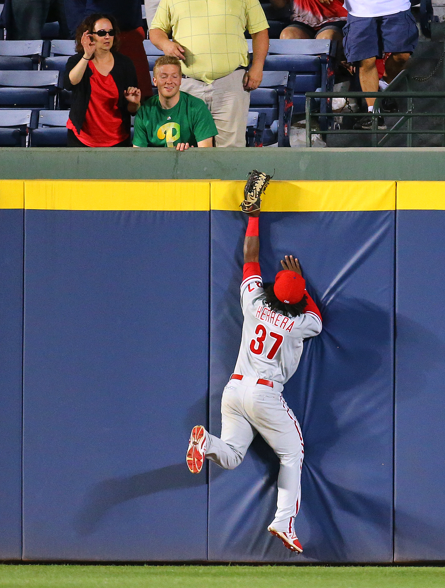 Philadelphia Phillies outfielder Odubel Herrera robs Atlanta Braves Jonny Gomes by catching the ball as he hits the wall during the sixth inning of a baseball game on Monday, May 4, 2015, in Atlanta. Curtis Compton(/Atlanta Journal-Constitution via AP)  M