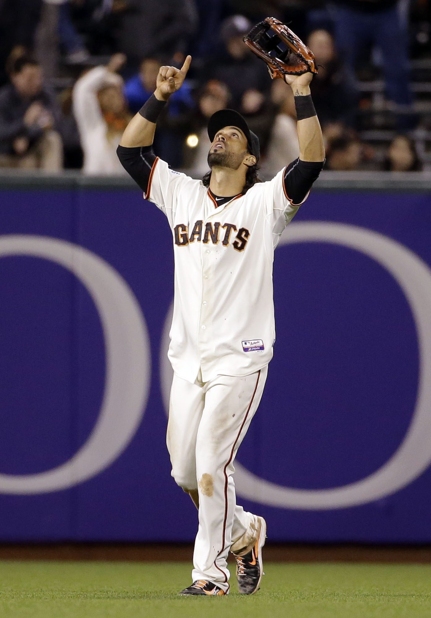 San Francisco Giants center fielder Angel Pagan celebrates after a 2-0 win over the San Diego Padres during a baseball game Monday, May 4, 2015, in San Francisco. (AP Photo/Marcio Jose Sanchez)