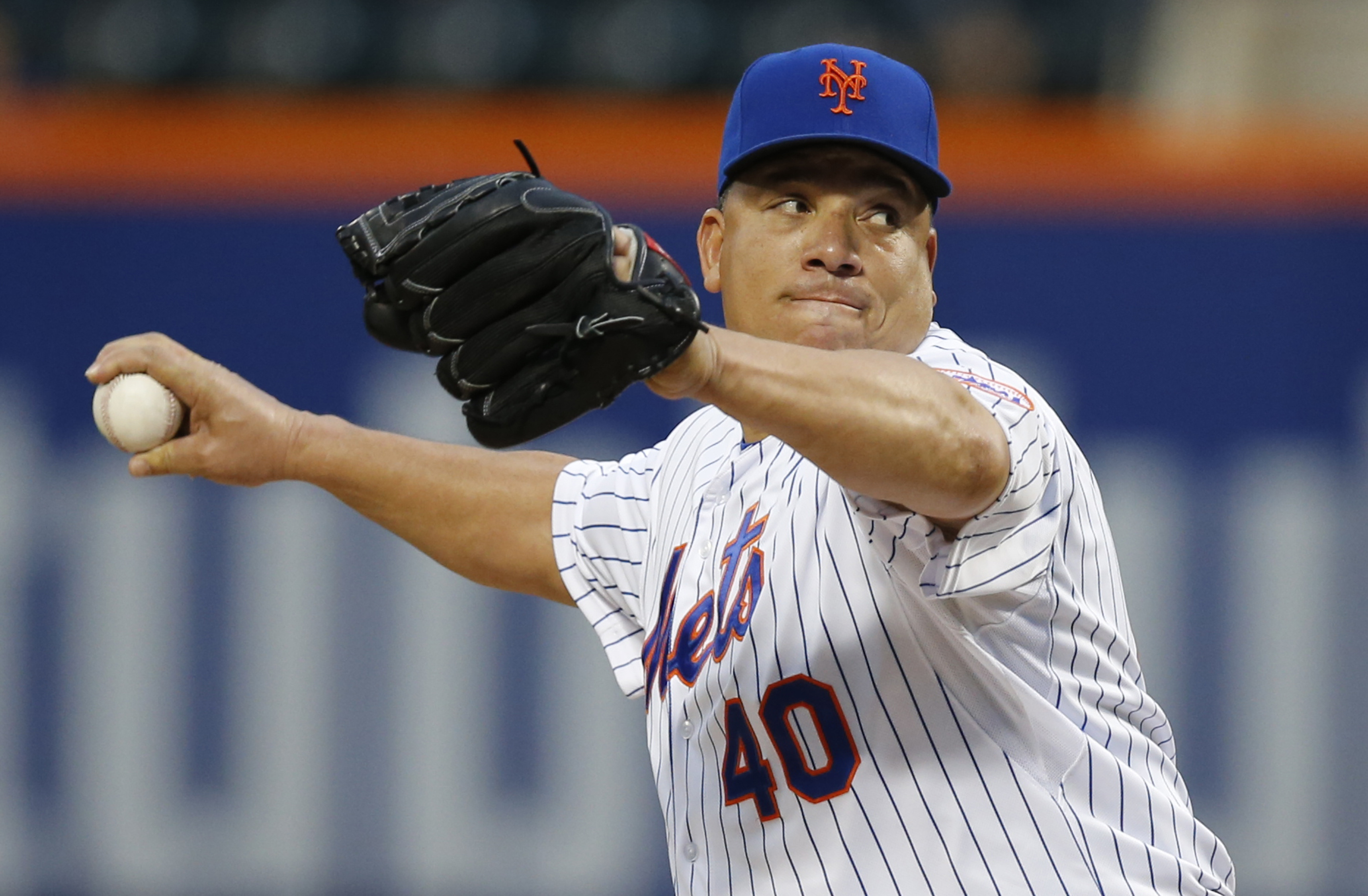 New York Mets starting pitcher Bartolo Colon delivers in the first inning of a baseball game against the Baltimore Orioles in New York, Tuesday, May 5, 2015. (AP Photo/Kathy Willens)