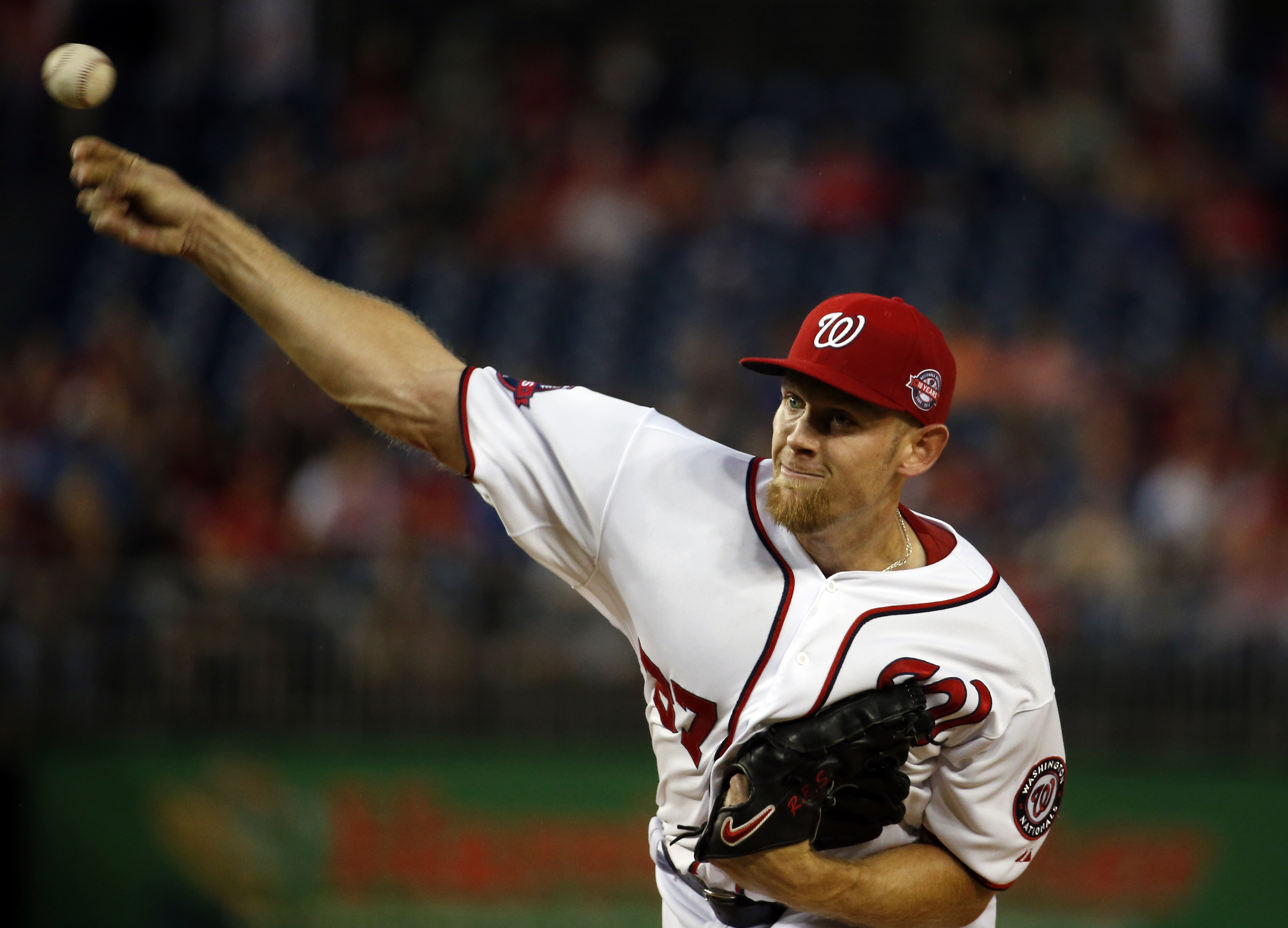 Washington Nationals starting pitcher Stephen Strasburg (37) throws during the first inning of a baseball game against the Miami Marlins at Nationals Park, Tuesday, May 5, 2015, in Washington. (AP Photo/Alex Brandon)
