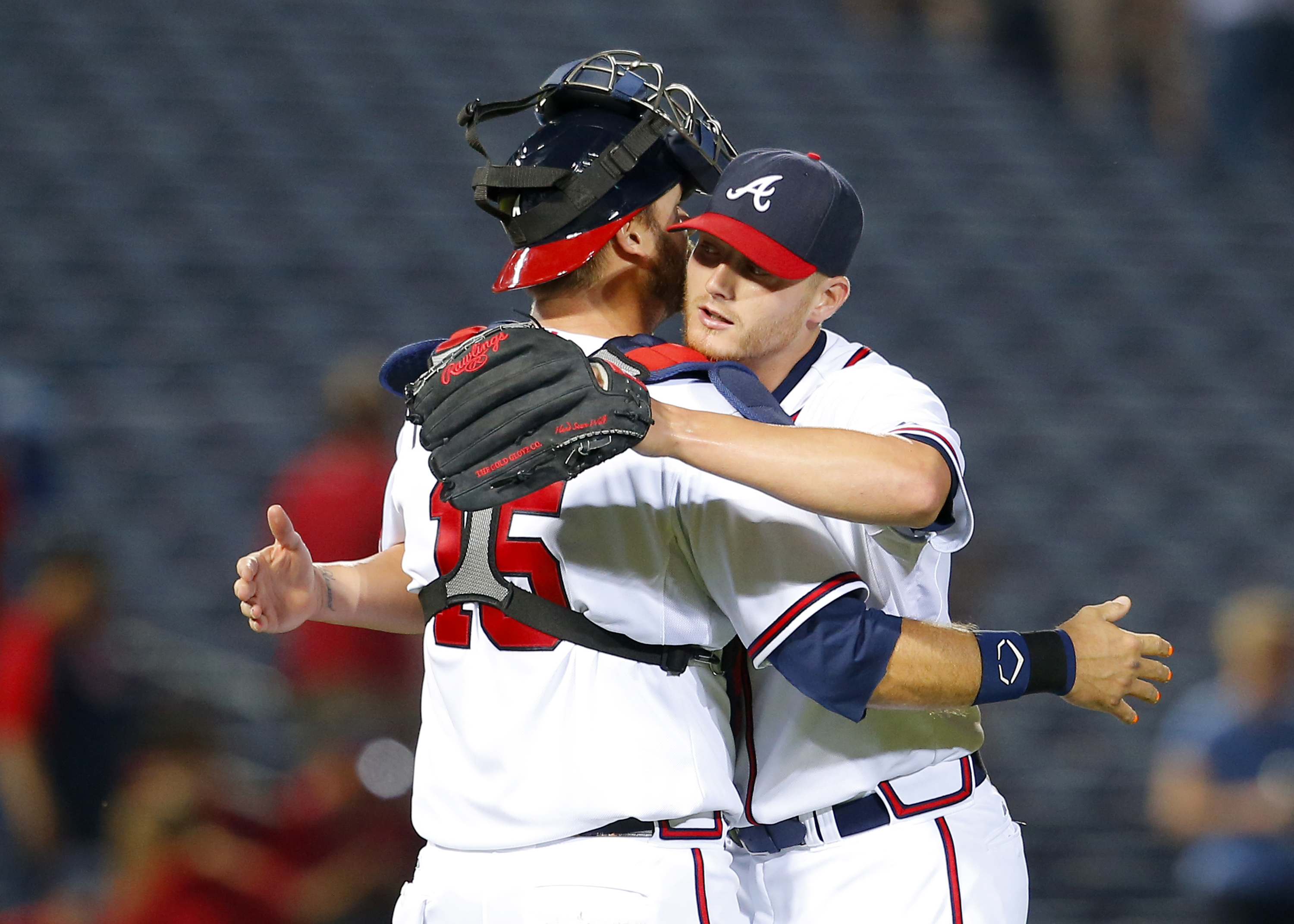 Atlanta Braves starting pitcher Shelby Miller, right, celebrates throwing a complete game with catcher A.J. Pierzynski (15) after a baseball game against the Philadelphia Phillies, Tuesday, May 5, 2015, in Atlanta. The Braves won the game 9-0. (AP Photo/T