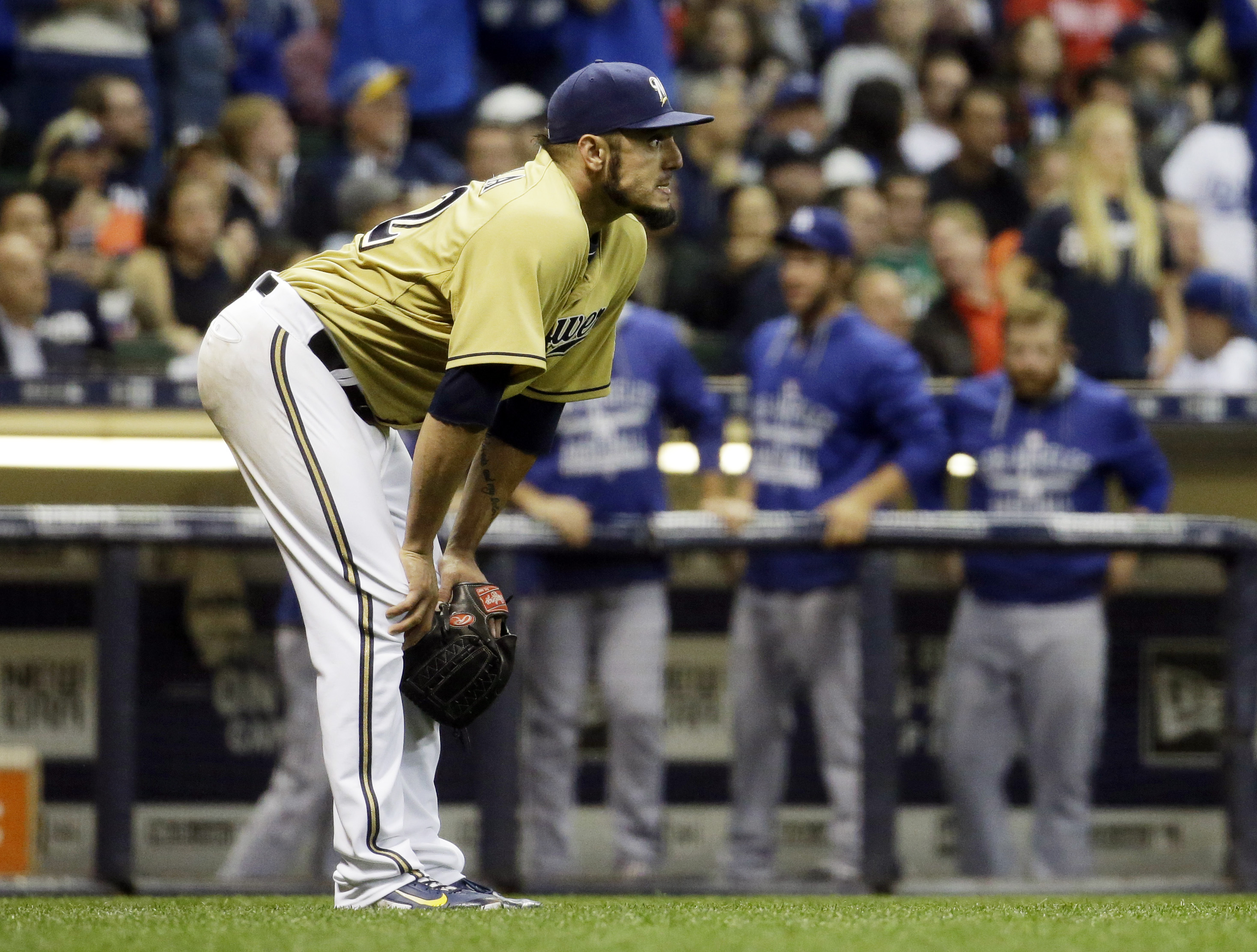 Milwaukee Brewers starting pitcher Matt Garza reacts after giving up a three-run home run to Los Angeles Dodgers' Justin Turner during the sixth inning of a baseball game Tuesday, May 5, 2015, in Milwaukee. (AP Photo/Morry Gash)