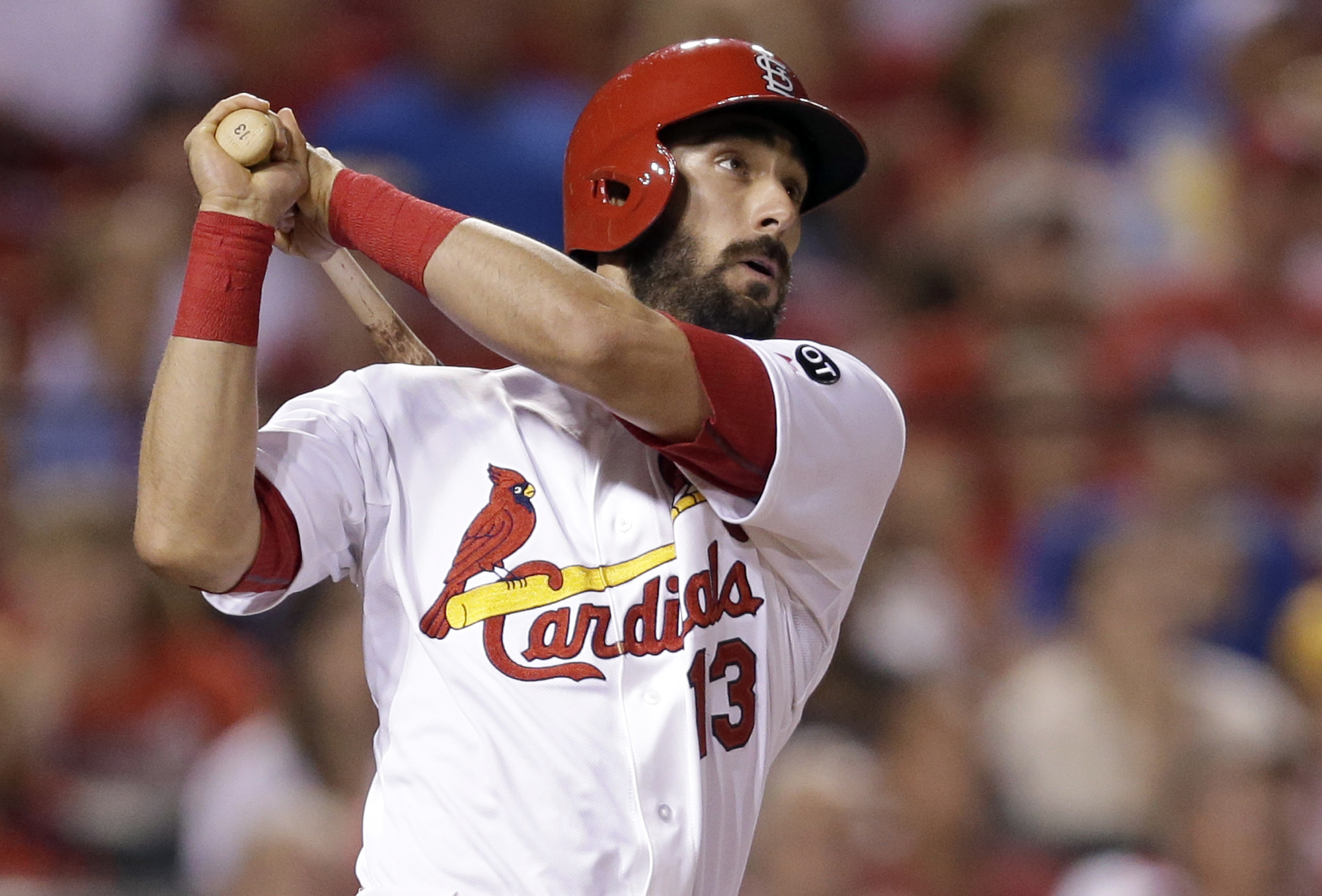 St. Louis Cardinals' Matt Carpenter watches his three-run home run during the fifth inning of a baseball game against the Chicago Cubs Tuesday, May 5, 2015, in St. Louis. (AP Photo/Jeff Roberson)