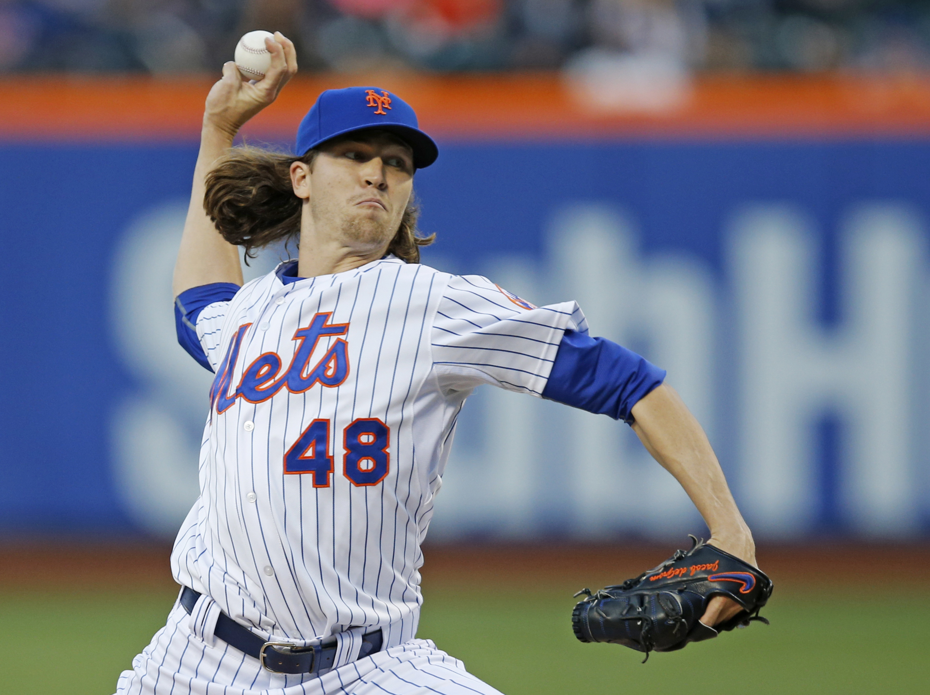 New York Mets starting pitcher Jacob deGrom delivers in the first inning of a baseball game against the Baltimore Orioles, Wednesday, May 6, 2015, in New York. (AP Photo/Kathy Willens)