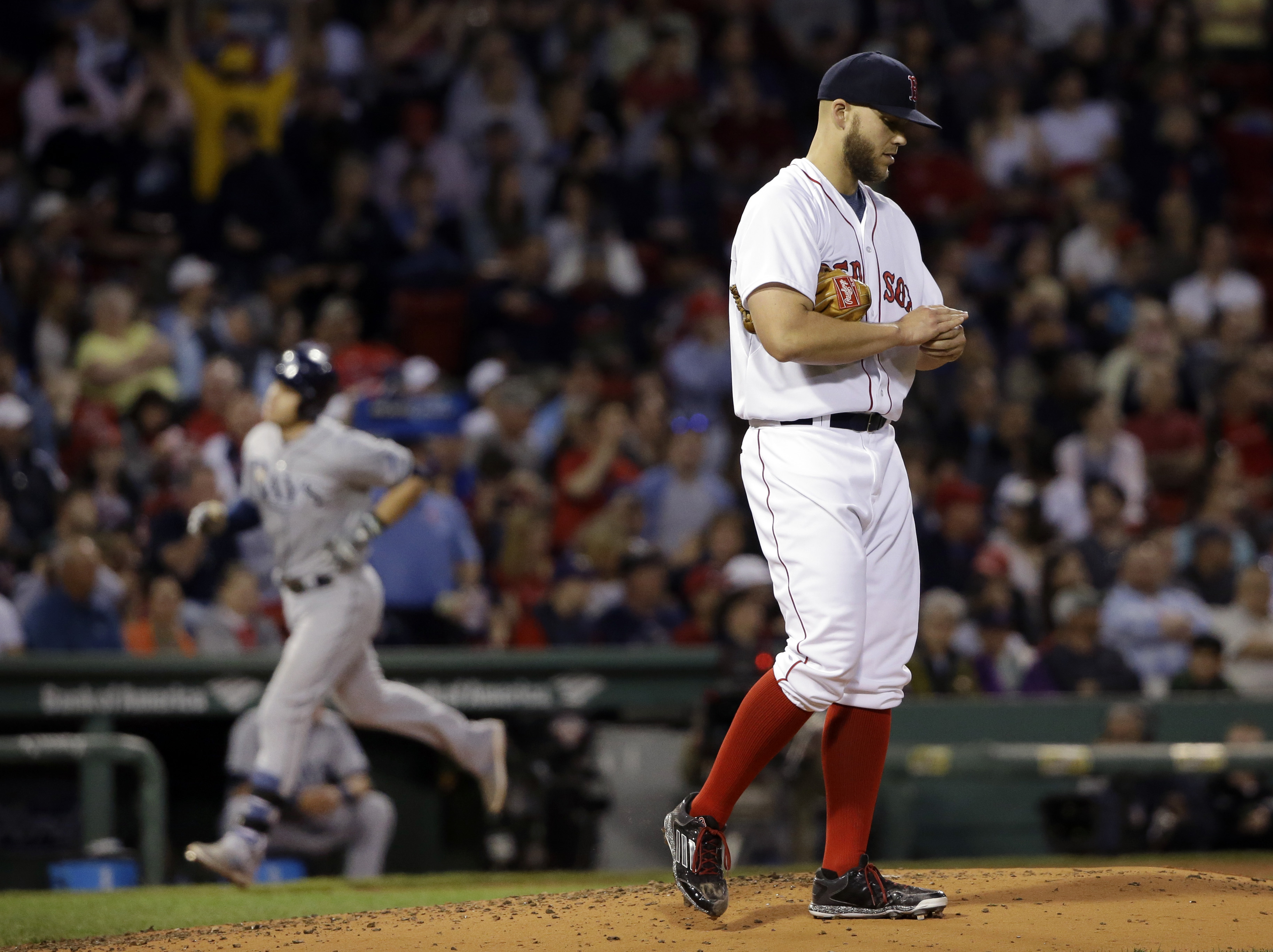 Boston Red Sox starting pitcher Justin Masterson reacts as Tampa Bay Rays' Evan Longoria rounds third base with a solo homer in the fourth inning of a baseball game at Fenway Park in Boston, Wednesday, May 6, 2015. (AP Photo/Elise Amendola)