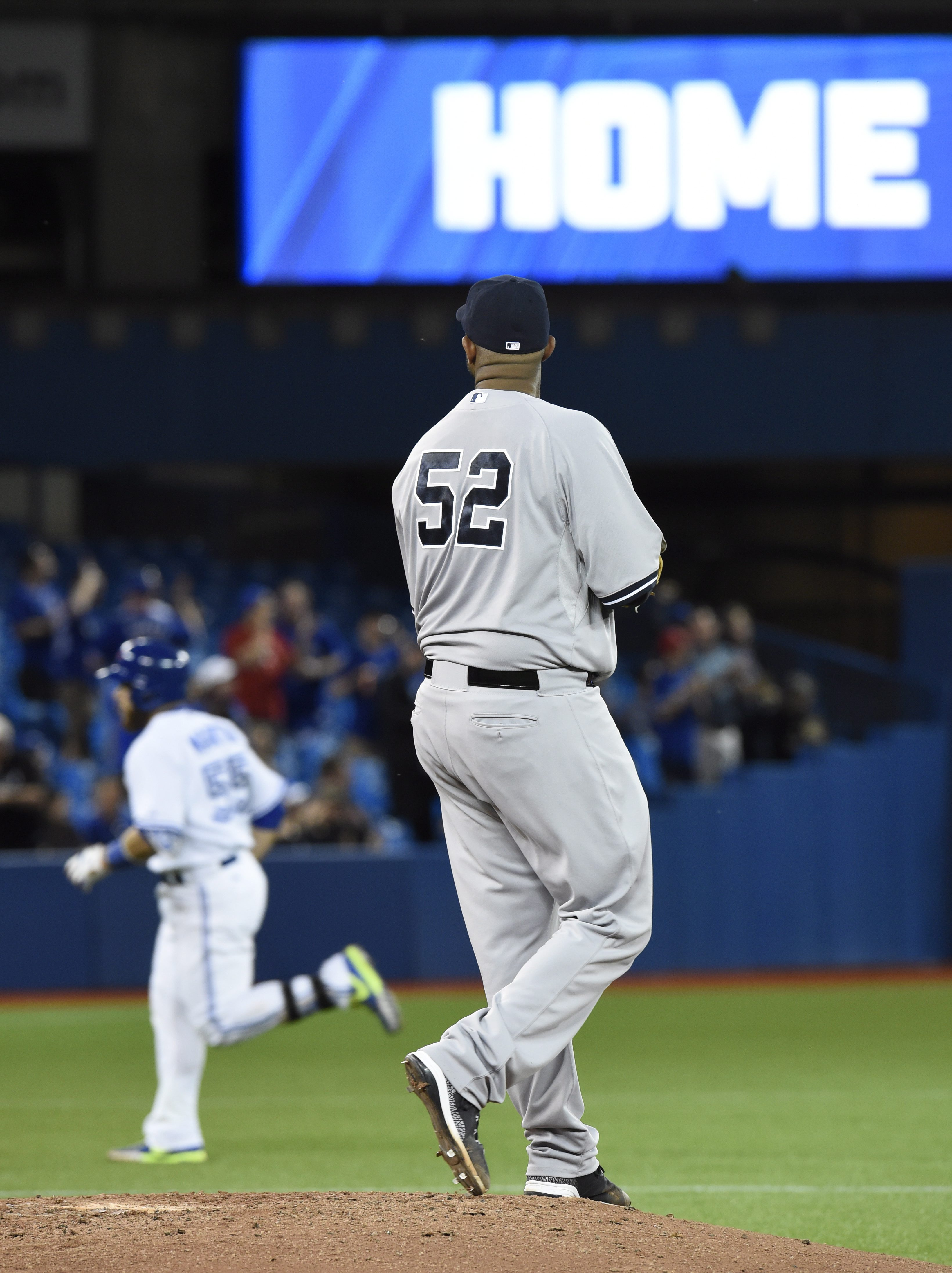 New York Yankees starting pitcher CC Sabathia watches Toronto Blue Jays' Russell Martin round the bases after hitting a home run during sixth inning American League baseball action in Toronto, Wednesday, May 6, 2015.   Frank Gunn(/The Canadian Press via A