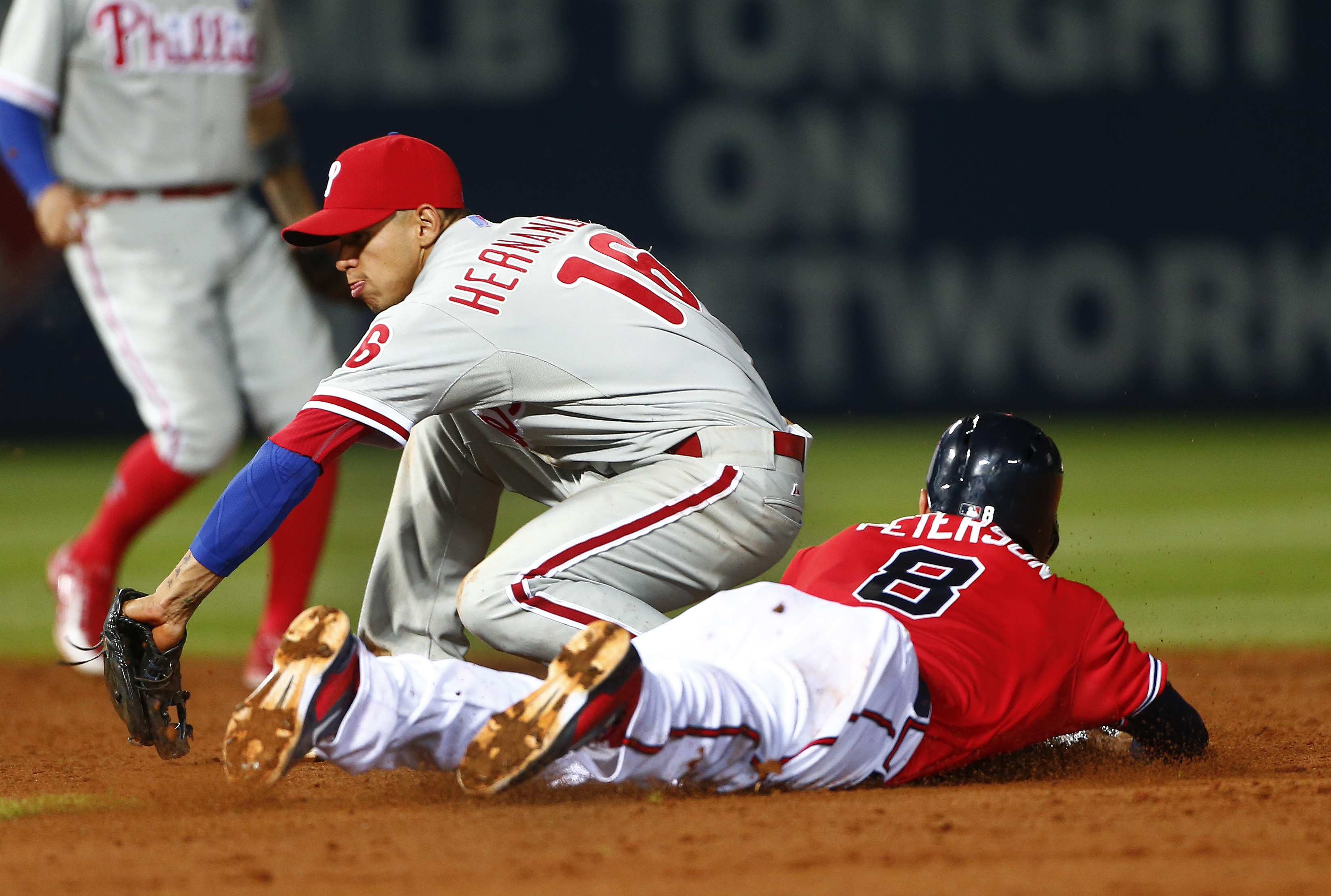 Atlanta Braves' Jace Peterson (8) steals second base as Philadelphia Phillies third baseman Cesar Hernandez (16) handles the late throw in the sixth inning of a baseball game Wednesday, May 6, 2015, in Atlanta. (AP Photo/John Bazemore)