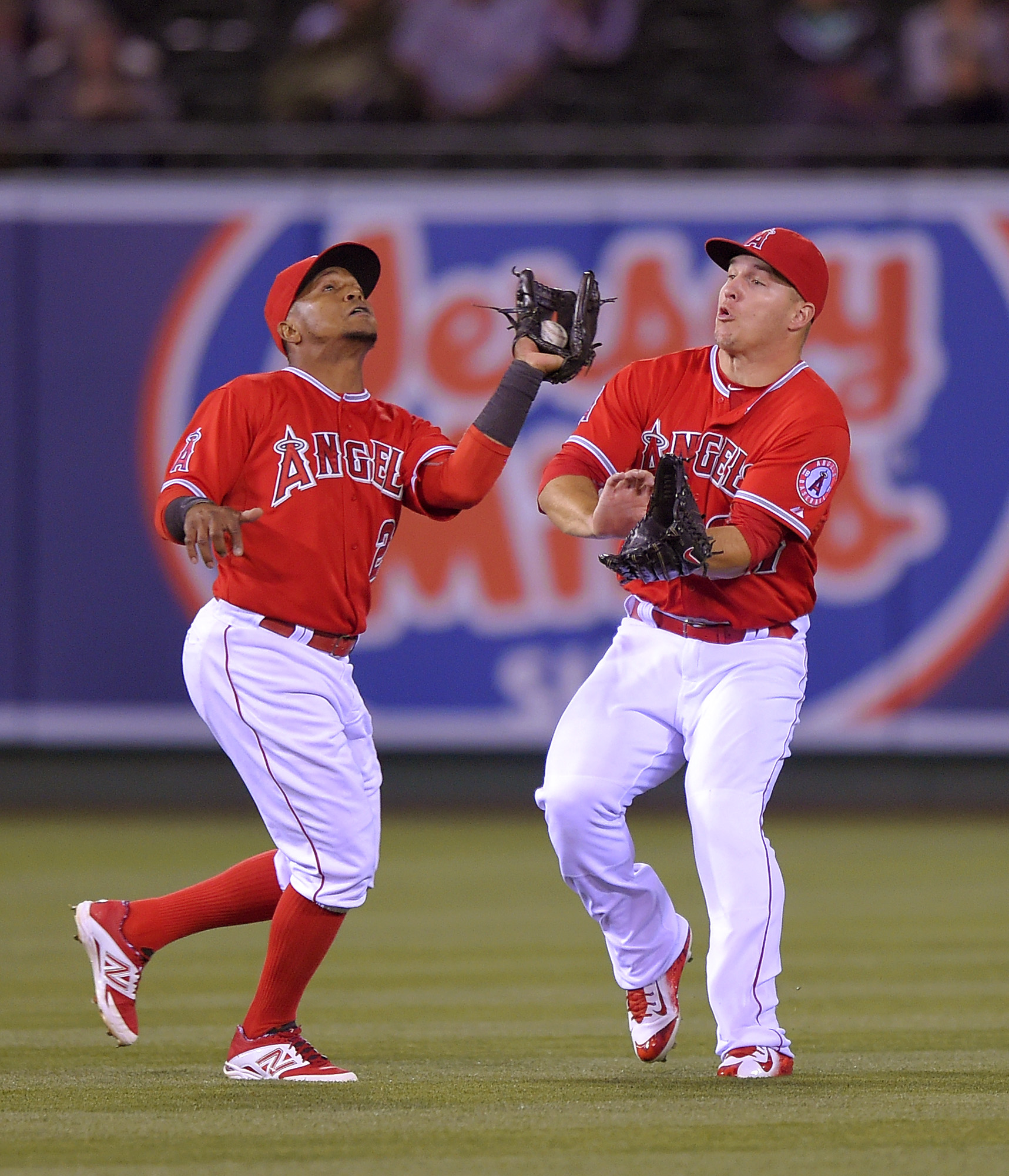 Los Angeles Angels shortstop Erick Aybar, left, makes a catch on a ball hit by Seattle Mariners' Mike Zunino before almost colliding with Mike Trout during the sixth inning of a baseball game, Wednesday, May 6, 2015, in Anaheim, Calif. (AP Photo/Mark J. T