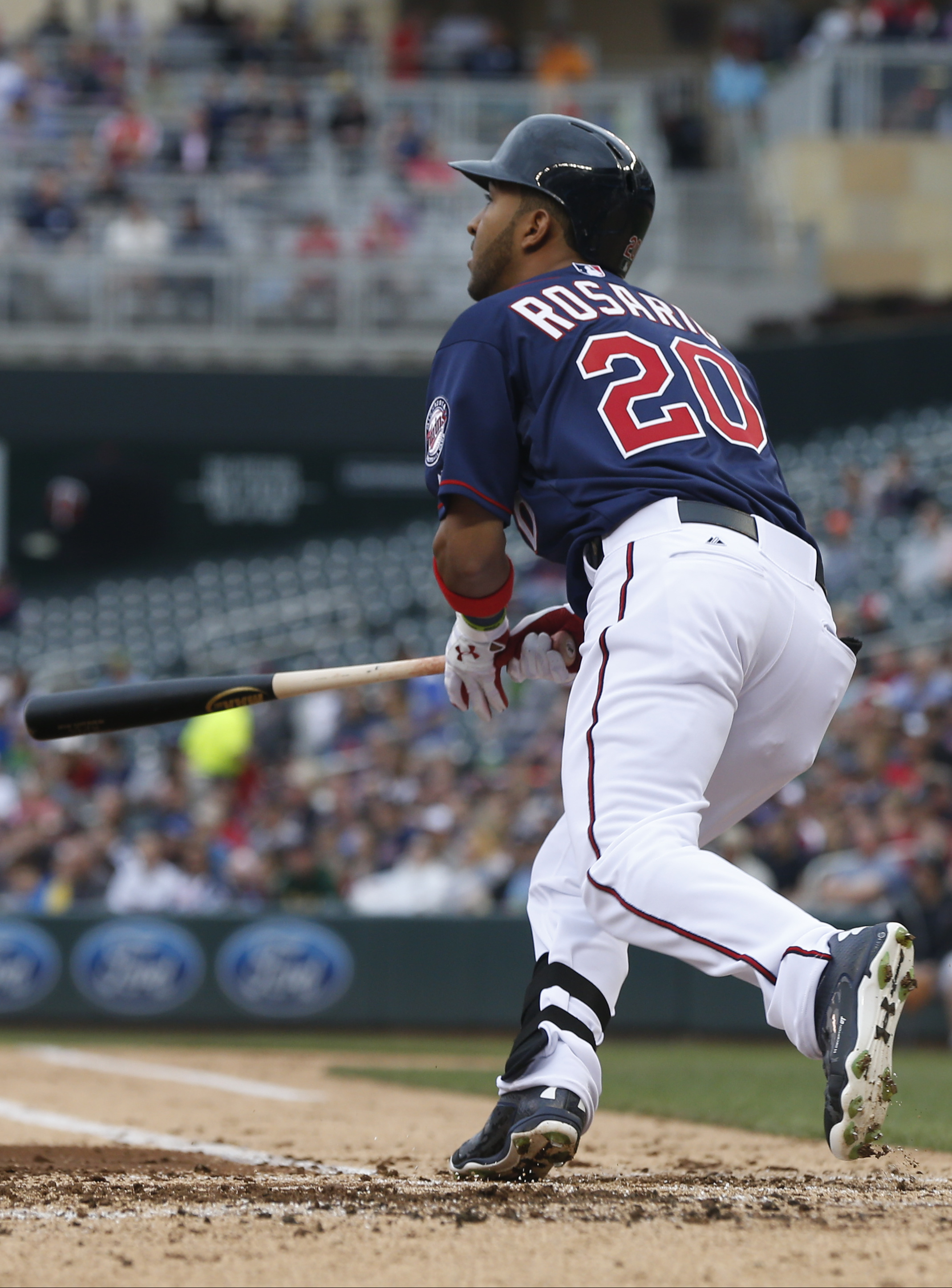 Minnesota Twins' Eddie Rosario watches his sacrifice fly off Oakland Athletics pitcher Drew Pomeranz in the third inning of a baseball game, Thursday, May 7, 2015, in Minneapolis. (AP Photo/Jim Mone)