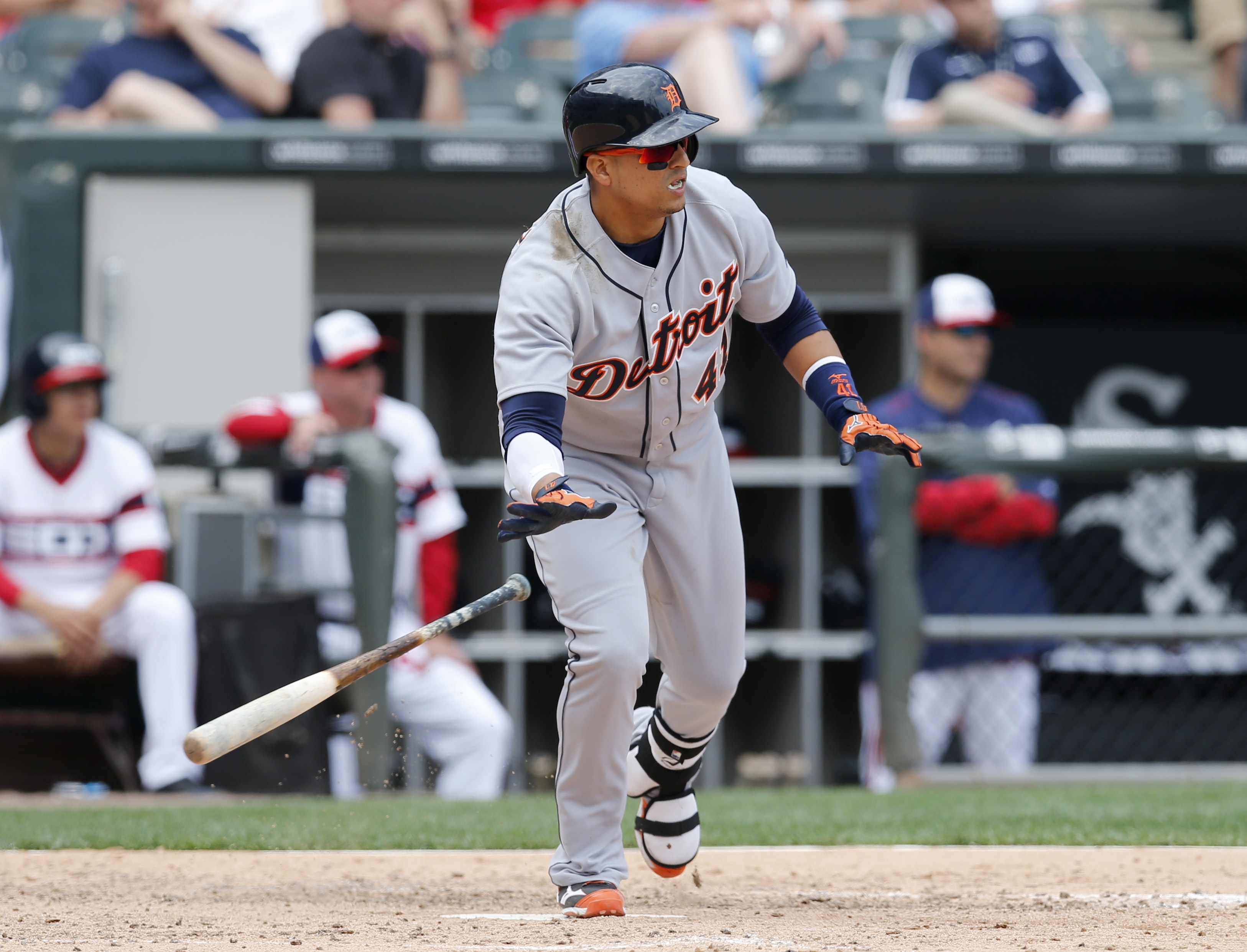 Detroit Tigers' Victor Martinez watches his RBI single off Chicago White Sox relief pitcher Dan Jennings, scoring Ian Kinsler, during the eighth inning of a baseball game Thursday, May 7, 2015, in Chicago. (AP Photo/Charles Rex Arbogast)