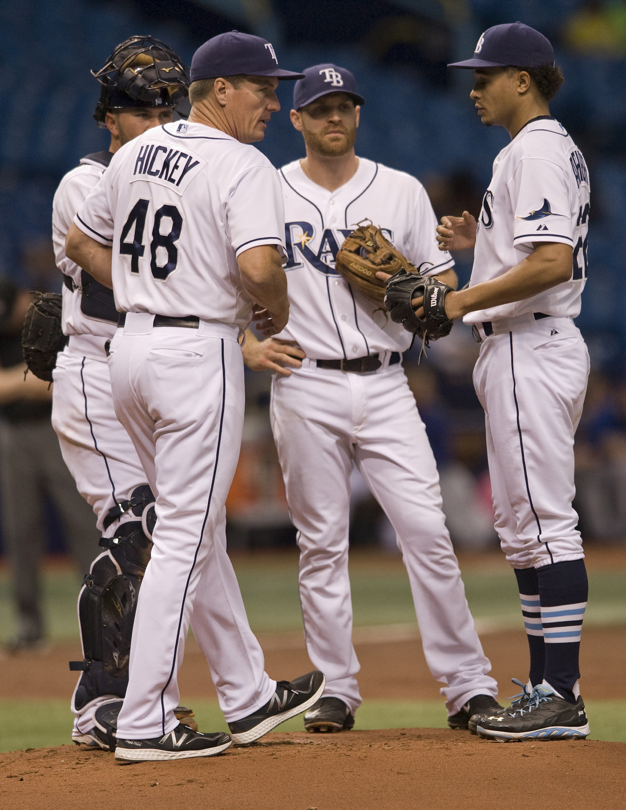 Tampa Bay Rays pitching coach Jim Hickey (48) comes to the mound to talk with catcher Bobby Wilson, left, infielder Logan Forsythe, center, and starting pitcher Chris Archer, right, after Archer walked in back-to-back runs during the second inning of a ba