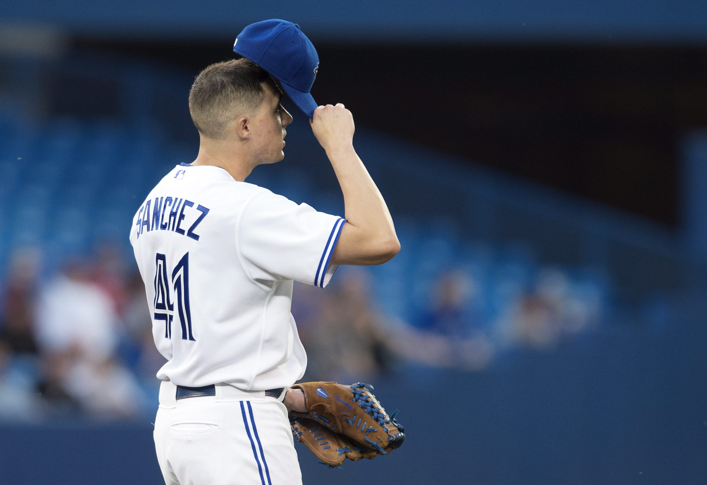 Toronto Blue Jays starting pitcher Aaron Sanchez reacts after walking two straight batters during fourth-inning MLB baseball game action against the Boston Red Sox in Toronto on Friday, May 8, 2015. (Darren Calabrese/The Canadian Press via AP) MANDATORY C