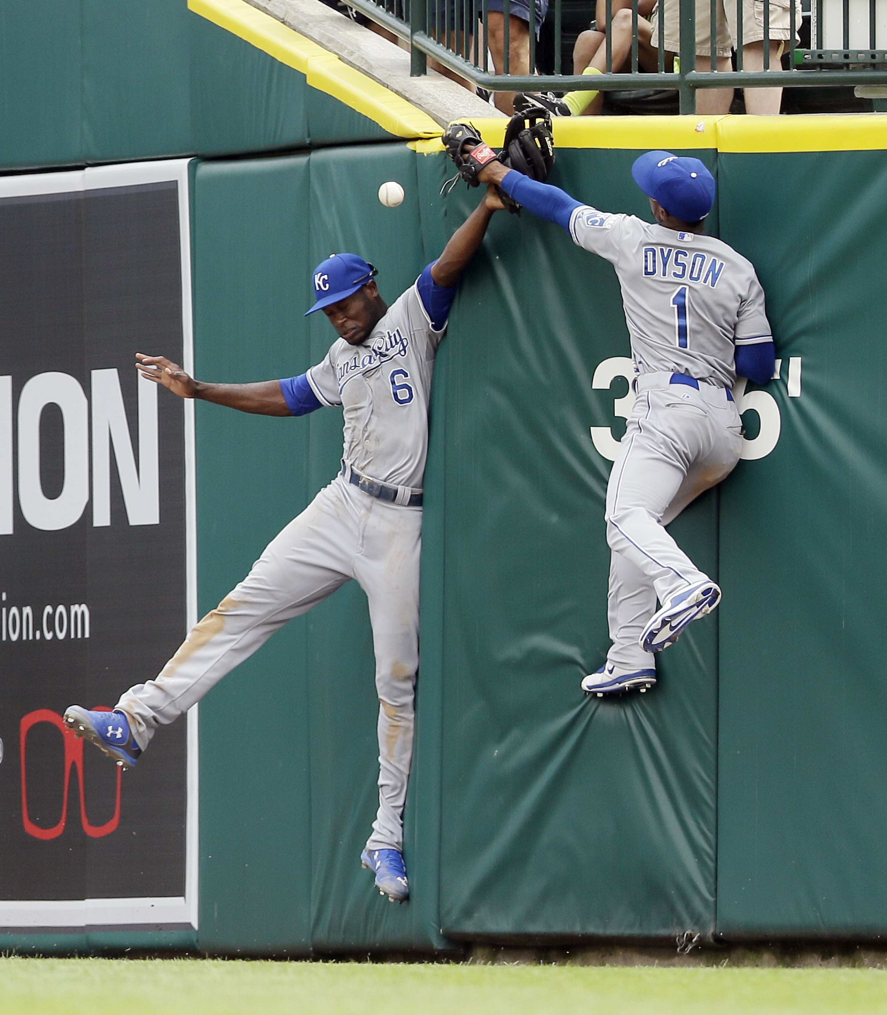Kansas City Royals center fielder Lorenzo Cain (6) and right fielder Jarrod Dyson (1) misplay the triple hit by Detroit Tigers' Nick Castellanos during the sixth inning of a baseball game, Saturday, May 9, 2015, in Detroit. (AP Photo/Carlos Osorio)