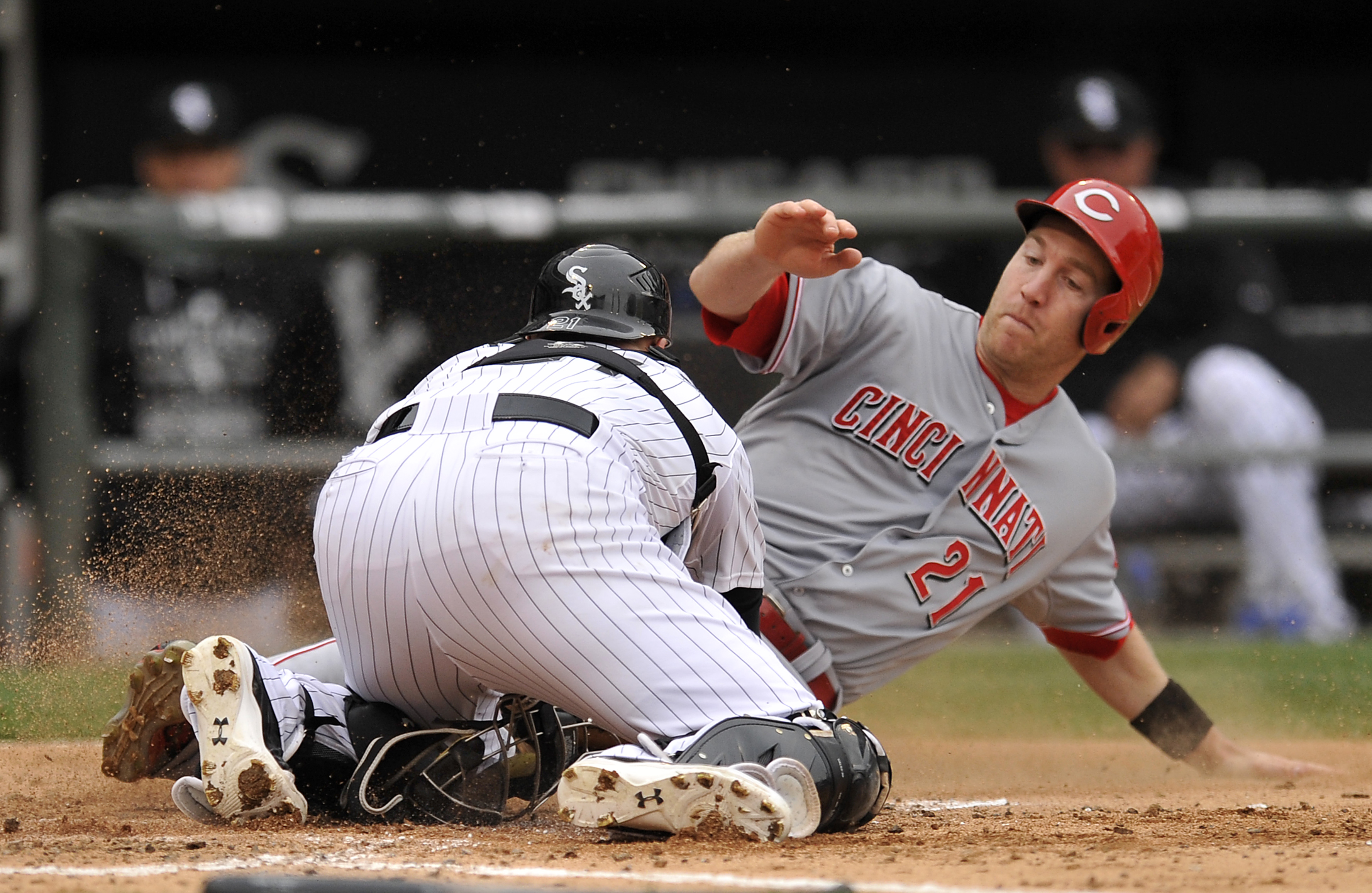 Cincinnati Reds' Todd Fraizer (21) slides into home plate while being tagged out by Chicago White Sox catcher Tyler Flowers during the third inning of the first game of a baseball doubleheader Saturday, May 9, 2015, in Chicago. (AP Photo/Paul Beaty)