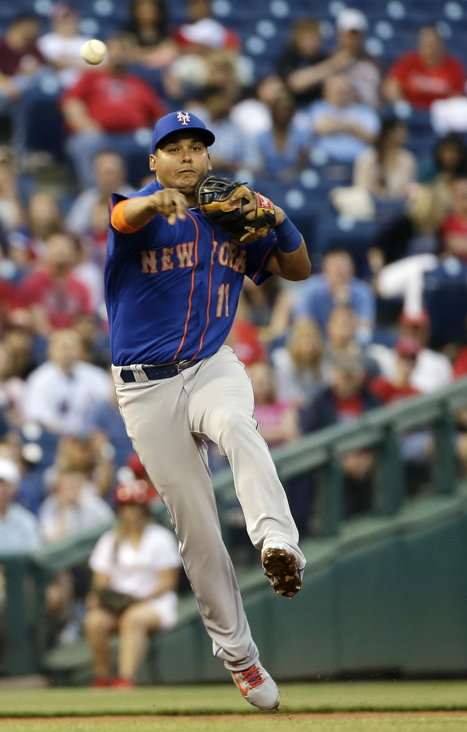 New York Mets shortstop Ruben Tejada throws to first base on a ground out by Philadelphia Phillies' Odubel Herrera during the third inning of a baseball game, Saturday, May 9, 2015, in Philadelphia. (AP Photo/Matt Slocum)