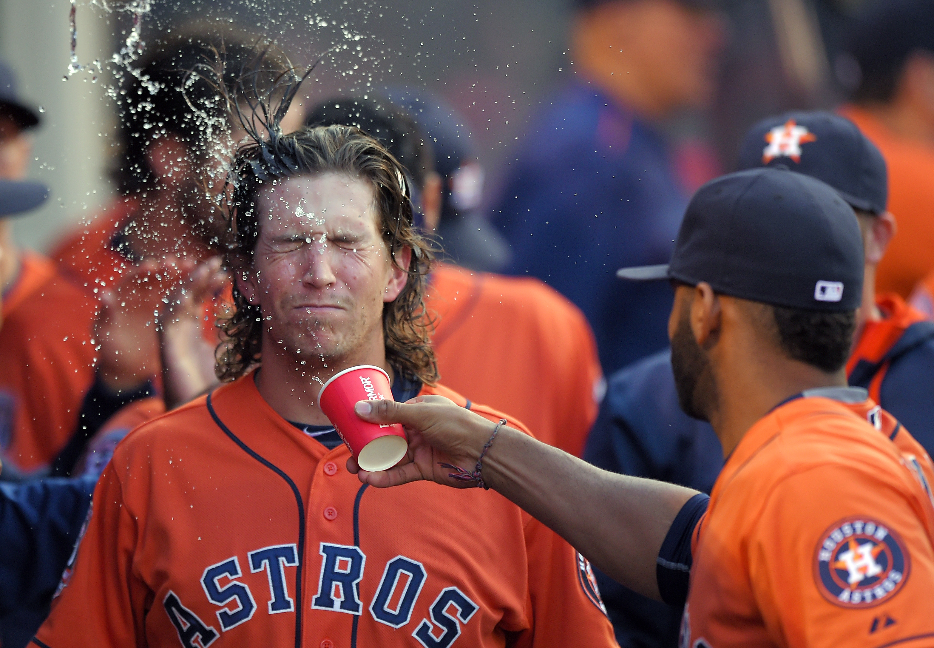 Houston Astros' Colby Rasmus, left, gets a cup a water in the face from Jonathan Villar after hitting a two-run home run during the third inning of a baseball game against the Los Angeles Angels, Saturday, May 9, 2015, in Anaheim, Calif. (AP Photo/Mark J.