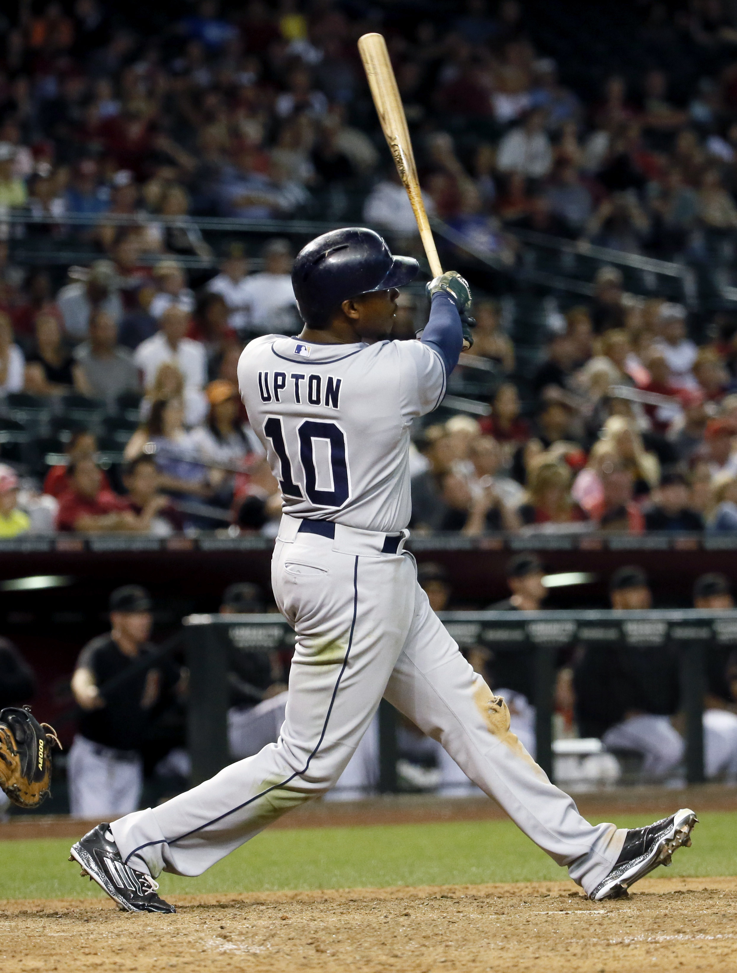 San Diego Padres' Justin Upton follows through on a solo home run against the Arizona Diamondbacks during the 12th inning of a baseball game, Saturday, May 9, 2015, in Phoenix. (AP Photo/Matt York)