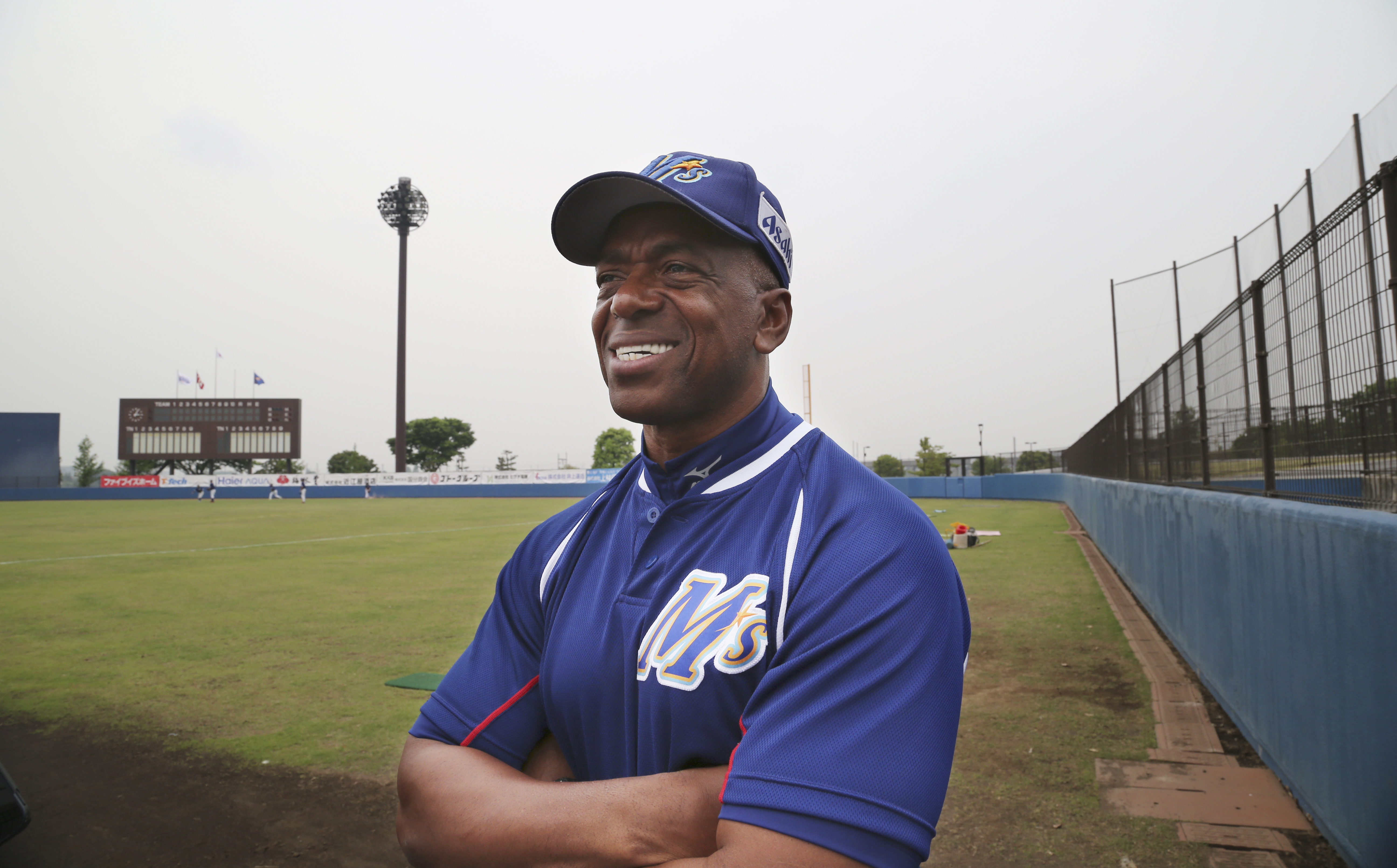 In this Saturday, May 9, 2015 photo, former Major League Baseball player and manager of Ishikawa Million Stars Julio Franco smiles during an interview with the Associated Press at a stadium in Konosu, north of Tokyo.  When Franco signed a contract with th