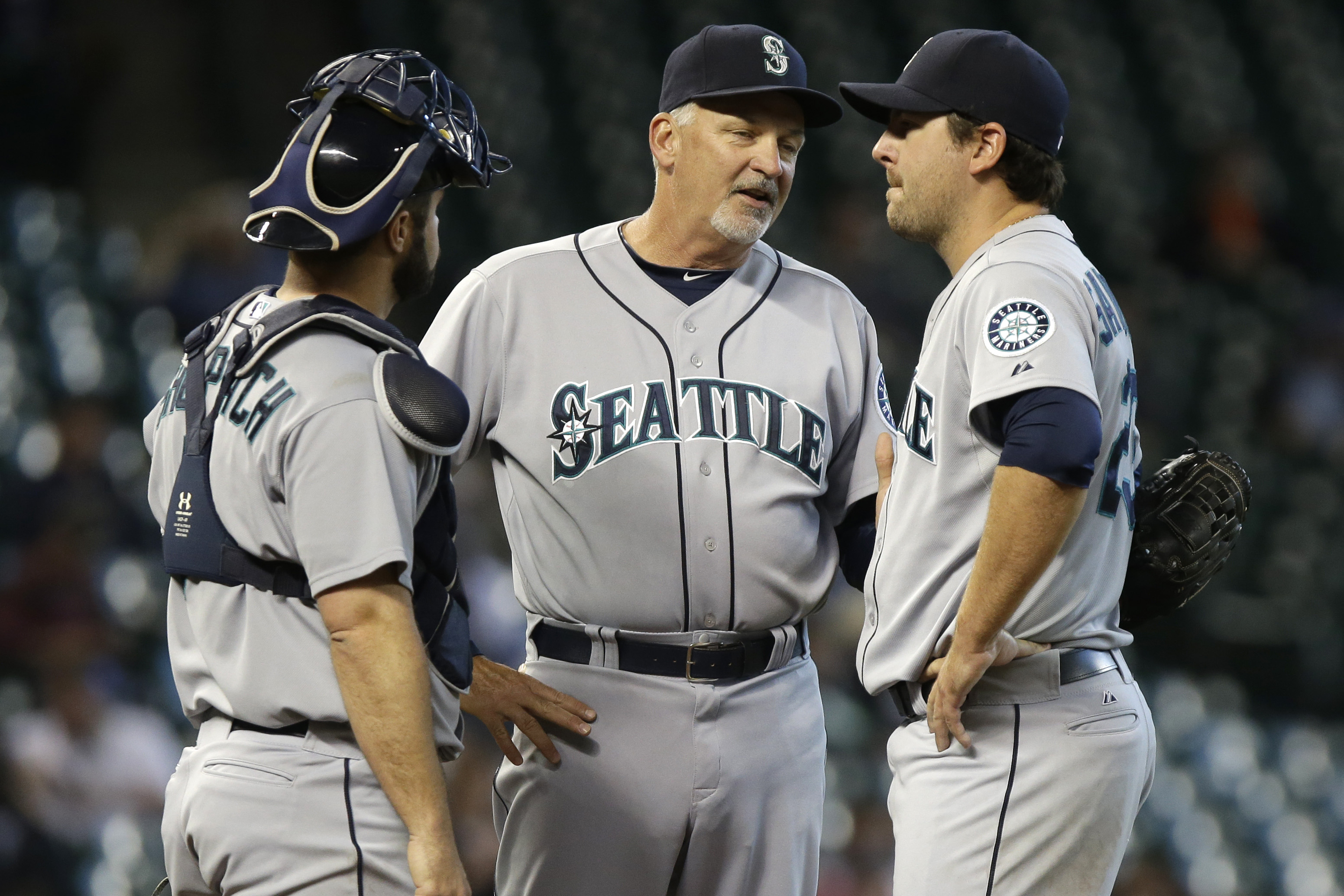 Seattle Mariners pitching coach Carl Willis, center, talks with starting pitcher Joe Saunders, right, and catcher Kelly Shoppach in the sixth inning of a baseball game against the Houston Astros Wednesday, April 24, 2013, in Houston. (AP Photo/Pat Sulliva