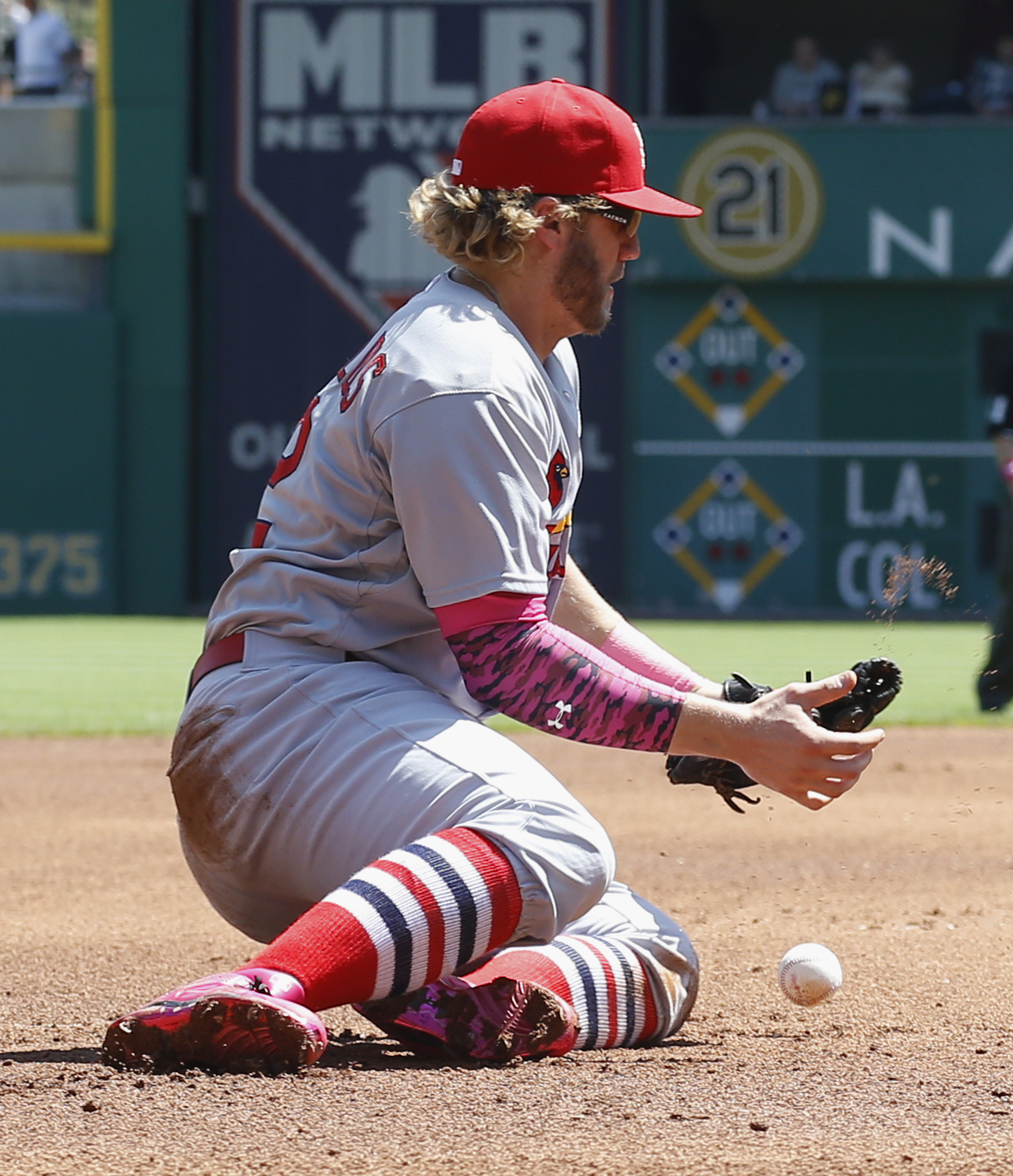 St. Louis Cardinals first baseman Mark Reynolds cannot field a ground ball by Pittsburgh Pirates' Jordy Mercer in the fourth inning of a baseball game, Sunday, May 10, 2015, in Pittsburgh. The play was scored a hit for Mercer and drove in Starling Marte w