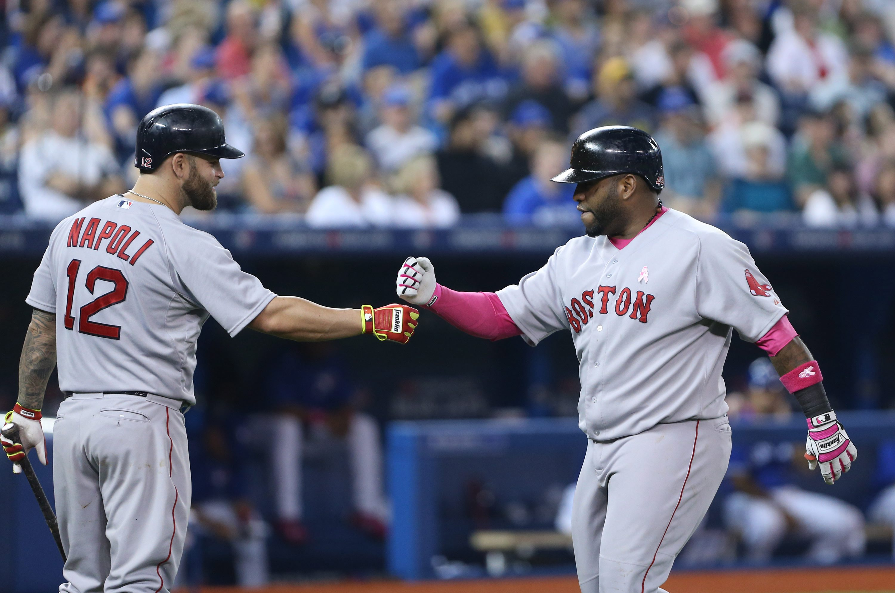 Boston Red Sox first baseman Mike Napoli (12), left, celebrates with Boston Red Sox third baseman Pablo Sandoval (48) after Sandoval hit a two-run homer in the 5th inning of the baseball game between the Toronto Blue Jays and Boston in Toronto on Sunday,