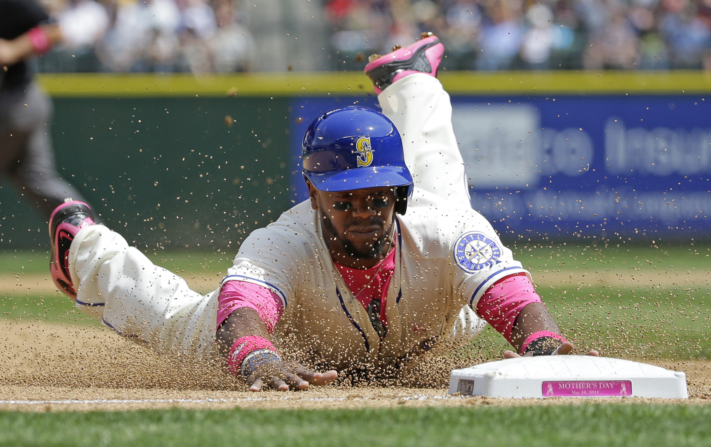 Seattle Mariners' Rickie Weeks dives safely into third base as he advances on a single hit by Mariners' Nelson Cruz in the fourth inning of a baseball game against the Oakland Athletics, Sunday, May 10, 2015, in Seattle. (AP Photo/Ted S. Warren)