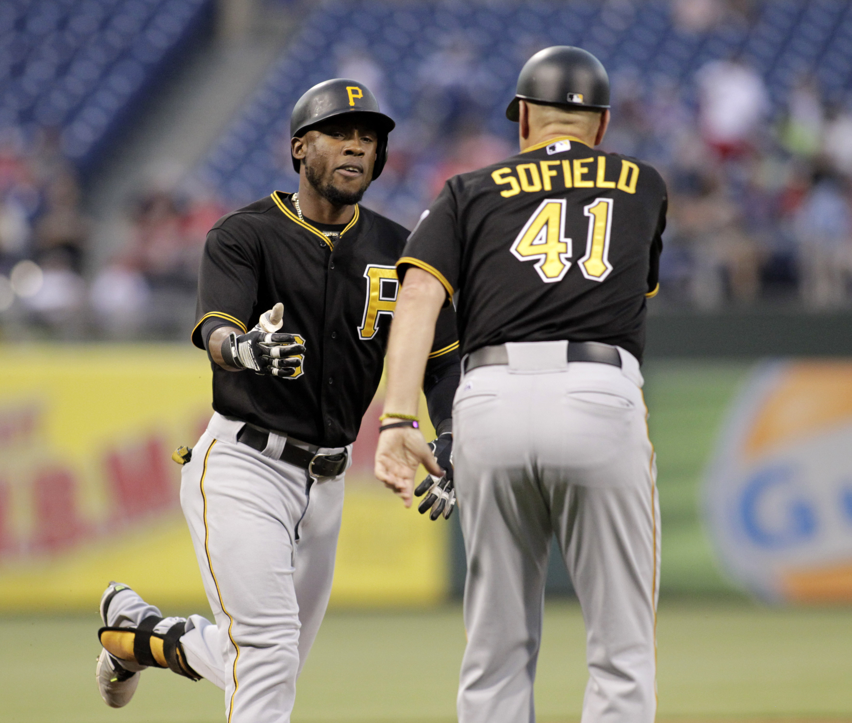 Pittsburgh Pirates' Starling Marte ,left celebrates with third base coach Rick Sofield after hitting a three run home run against the  Philadelphia Philles in the third inning of a baseball game, Monday, May 11, 2015 in Philadelphia. (AP Photo/H. Rumph Jr