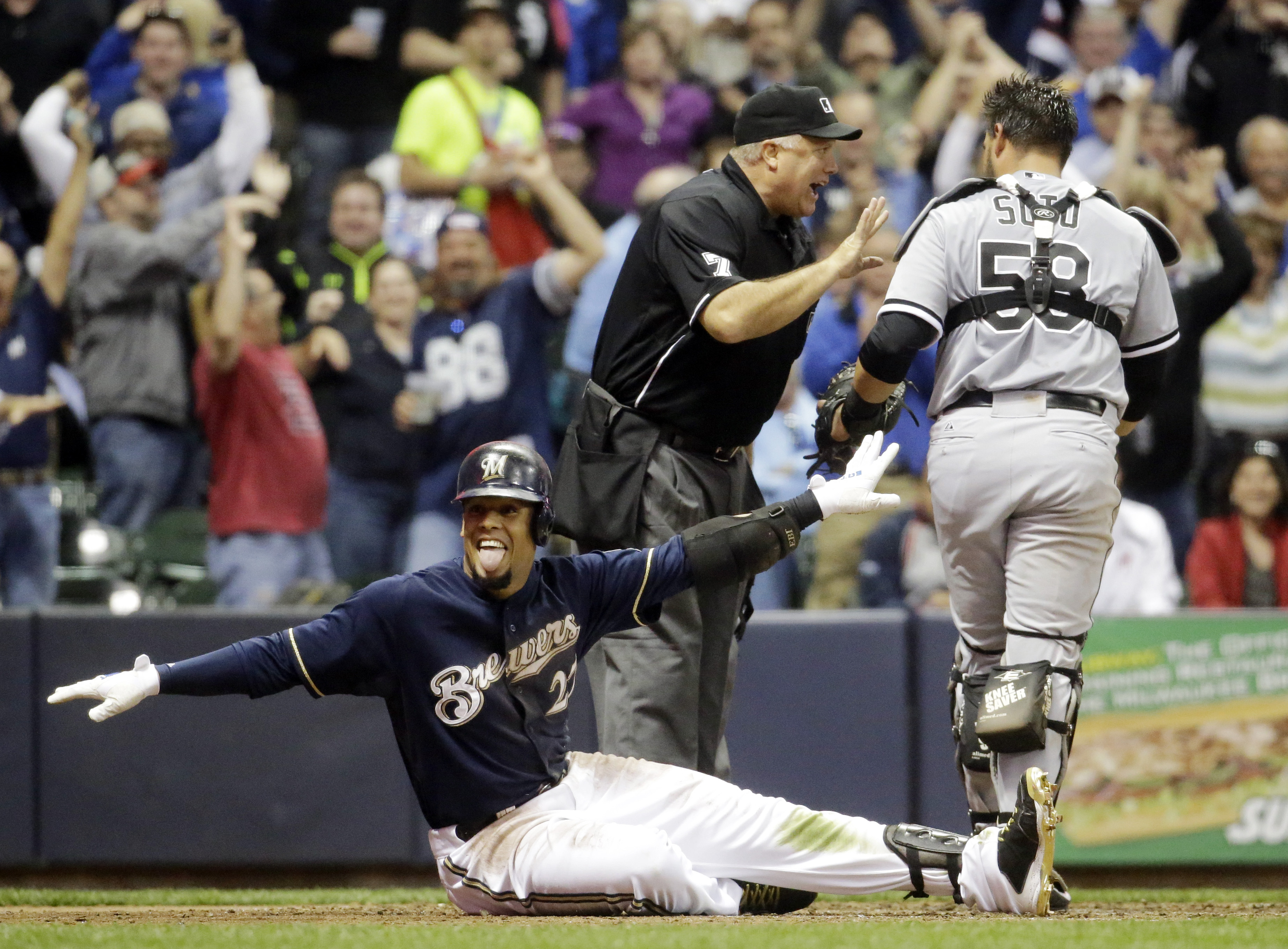 Chicago White Sox catcher Geovany Soto argues as Milwaukee Brewers' Carlos Gomez reacts after being called safe at home during the fifth inning of a baseball game Monday, May 11, 2015, in Milwaukee. Gomez was safe after hitting a triple and a throwing err