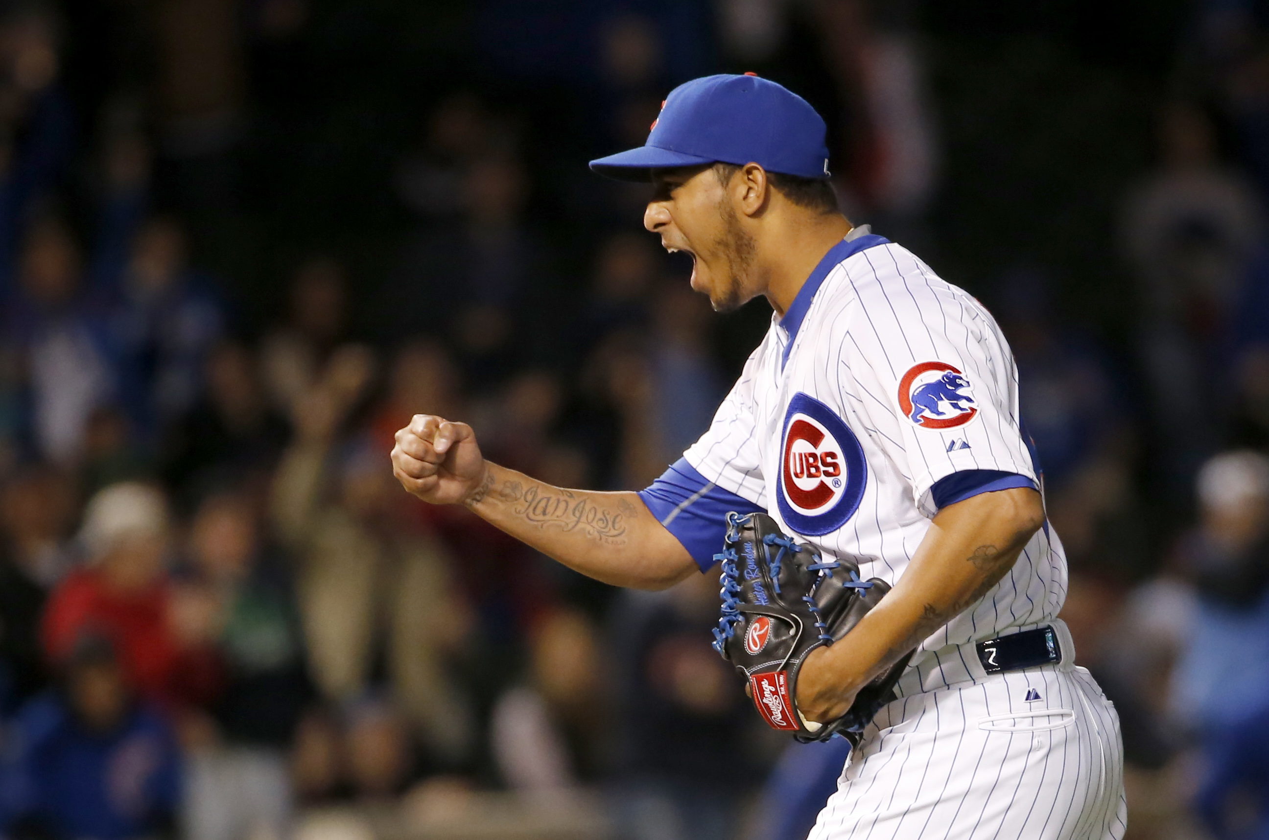 Chicago Cubs relief pitcher Hector Rondon celebrates the Cubs' 4-3 win over then New York Mets after a baseball game Monday, May 11, 2015, in Chicago. (AP Photo/Charles Rex Arbogast)