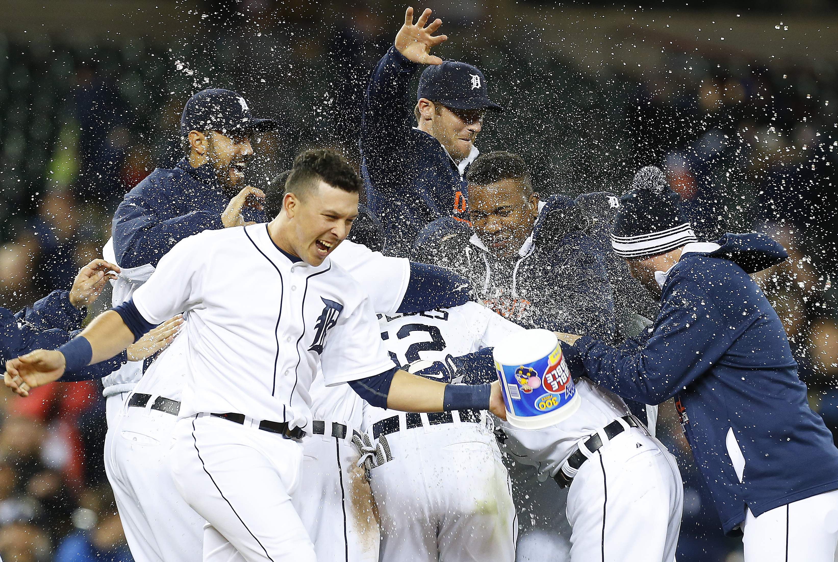 Detroit Tigers players celebrate an Ian Kinsler game winning single scoring Anthony Gose against the Minnesota Twins in the tenth inning of a baseball game in Detroit Tuesday, May 12, 2015. Detroit won 2-1. (AP Photo/Paul Sancya)