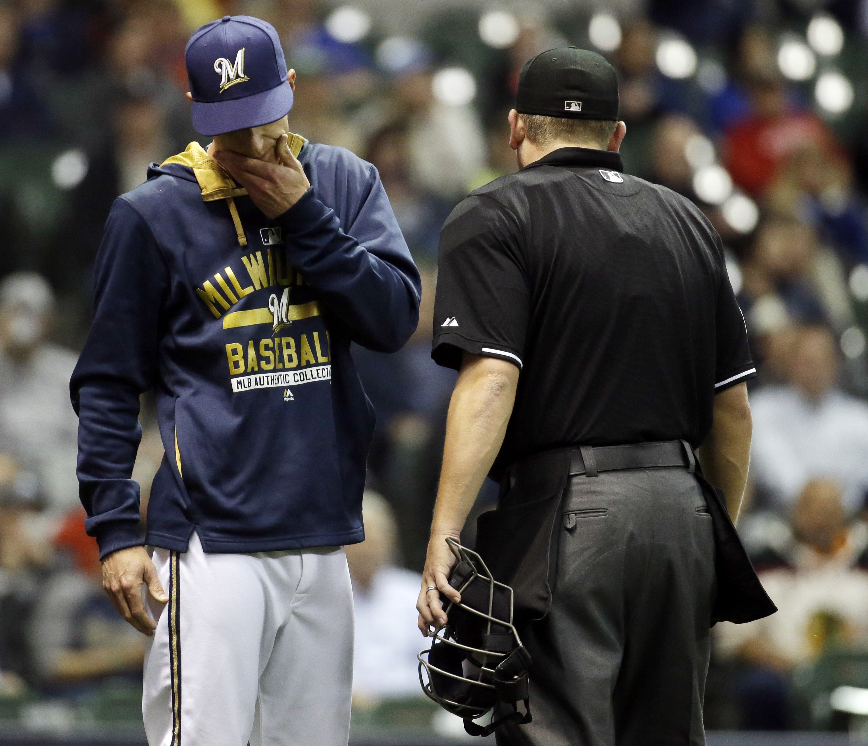 Milwaukee Brewers manager Craig Counsell reacts after arguing a catchers interference call with home plate umpire Clint Fagan during the ninth inning of a baseball game against the Chicago White Sox Tuesday, May 12, 2015, in Milwaukee. (AP Photo/Morry Gas