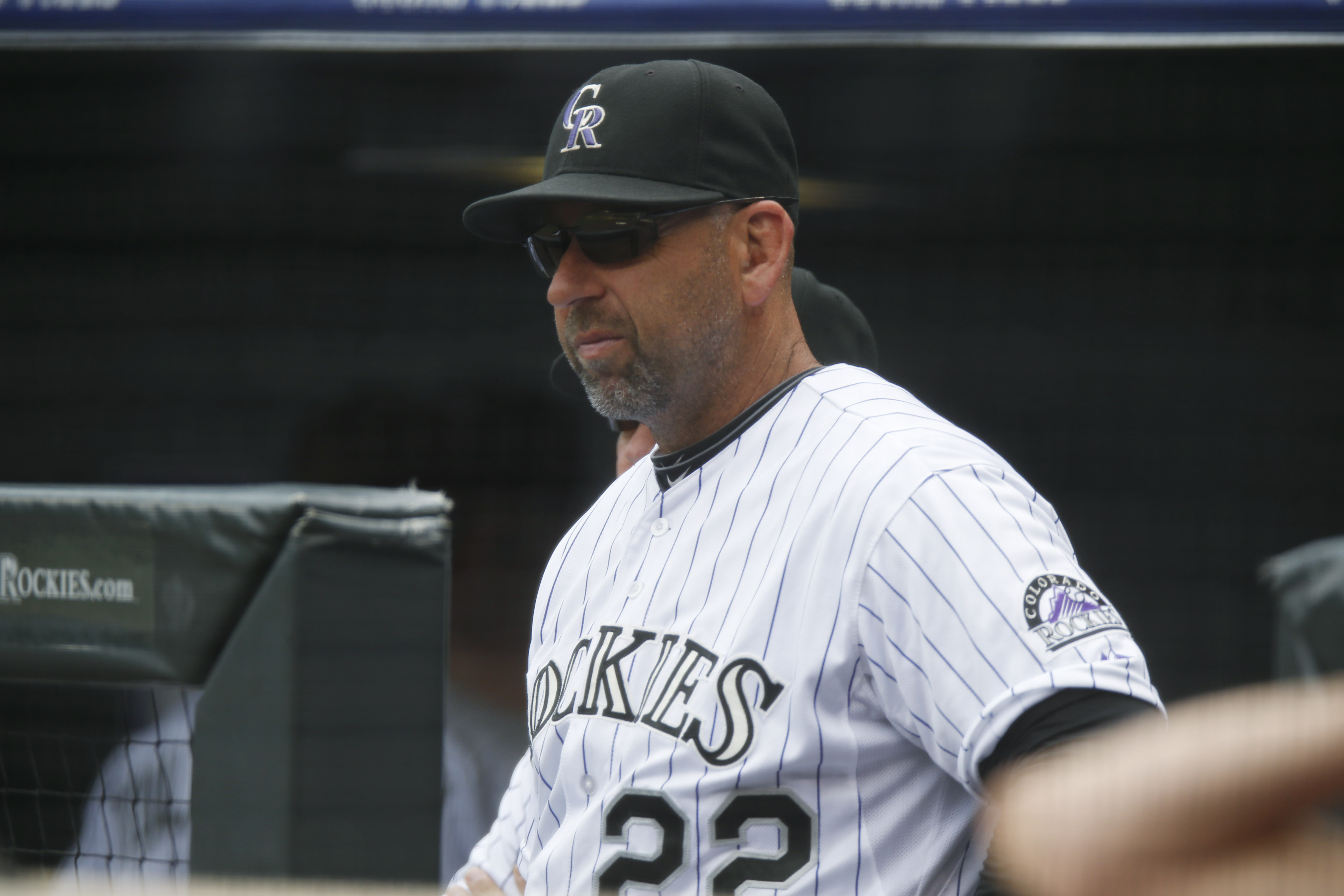 Colorado Rockies manager Walt Weiss (22) looks on against the San Diego Padres in the first inning of a baseball game Thursday, April 23, 2015, in Denver. (AP Photo/David Zalubowski)