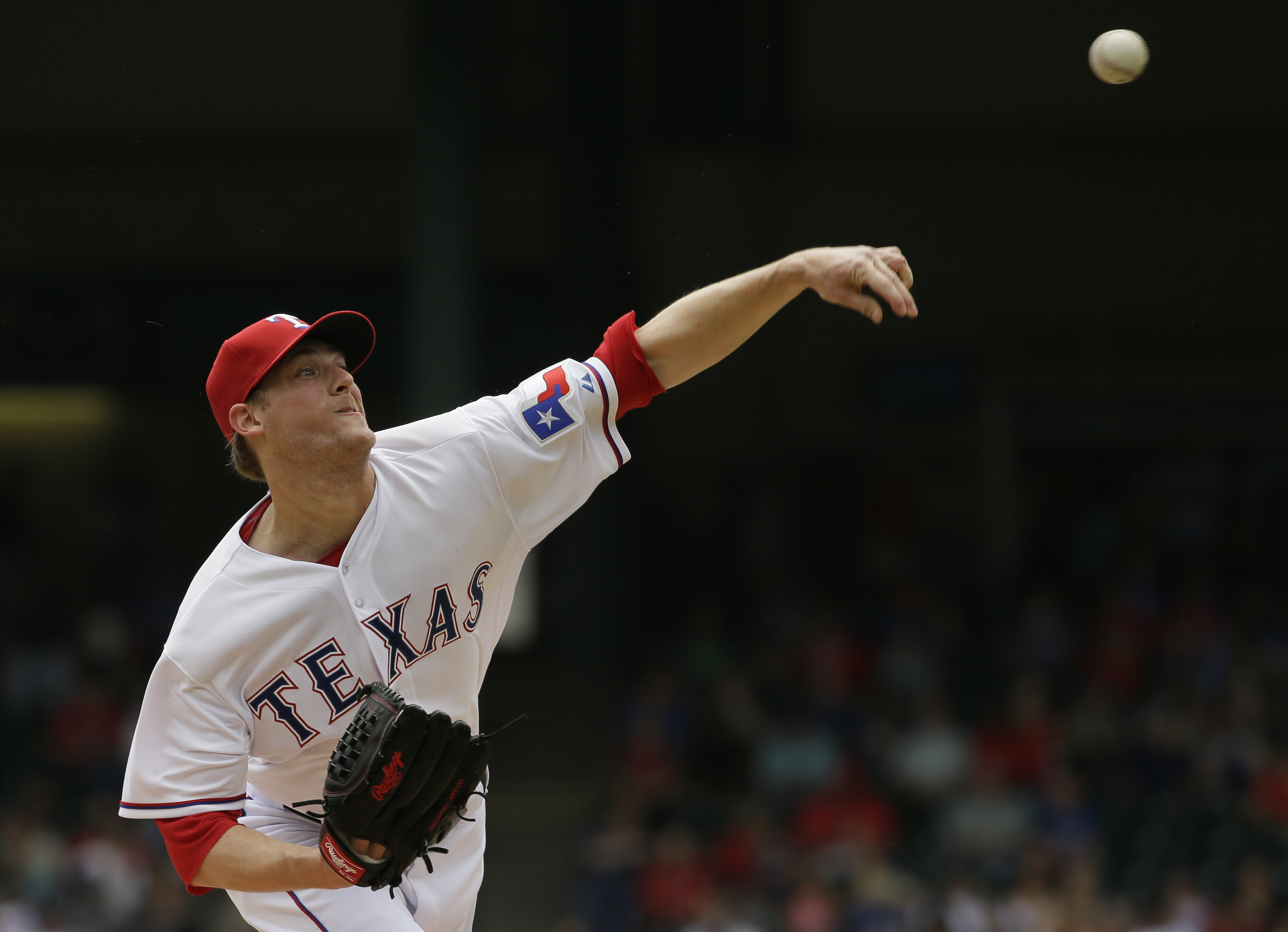 Texas Rangers starting pitcher Ross Detwiler throws during the first inning of a baseball game against the Kansas City Royals in Arlington, Texas, Thursday, May 14, 2015. (AP Photo/LM Otero)