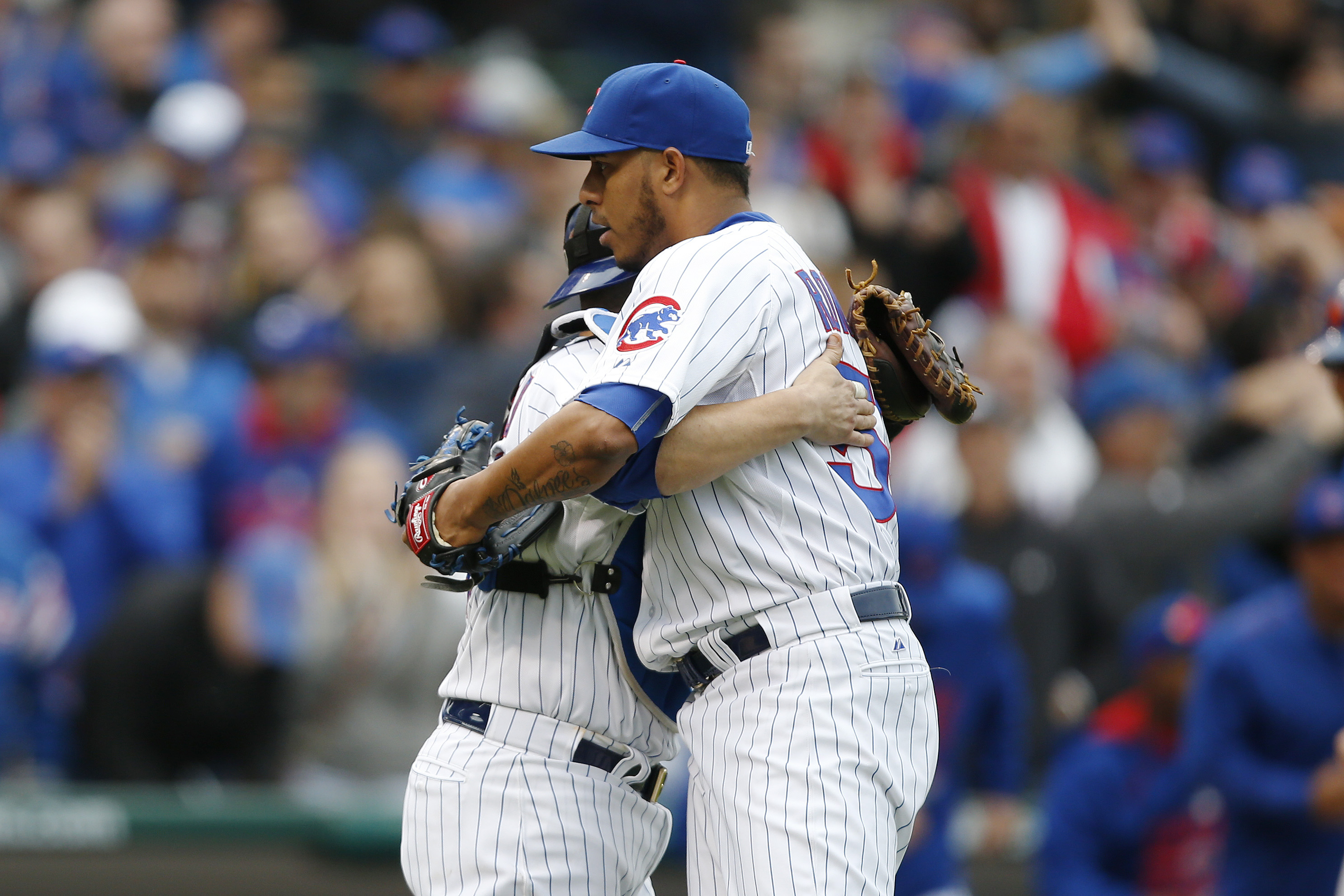 Chicago Cubs relief pitcher Hector Rondon (56) and catcher Miguel Montero (47) react after defeating the New York Mets 6-5 in a baseball game Thursday, May 14, 2015, in Chicago. (AP Photo/Andrew A. Nelles)