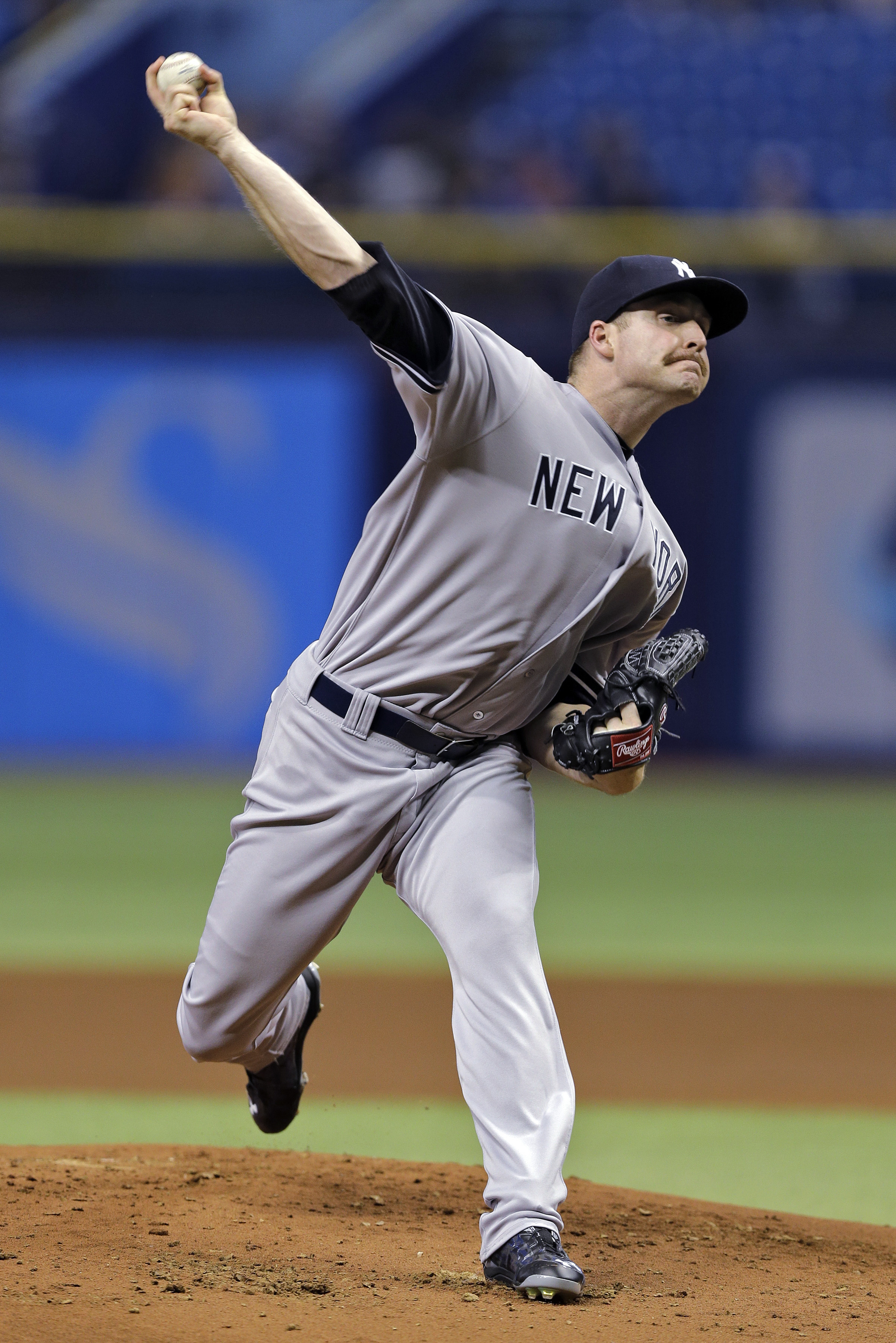 New York Yankees starting pitcher Chase Whitley delivers to the Tampa Bay Rays during the first inning of a baseball game Thursday, May 14, 2015, in St. Petersburg, Fla.  (AP Photo/Chris O'Meara)