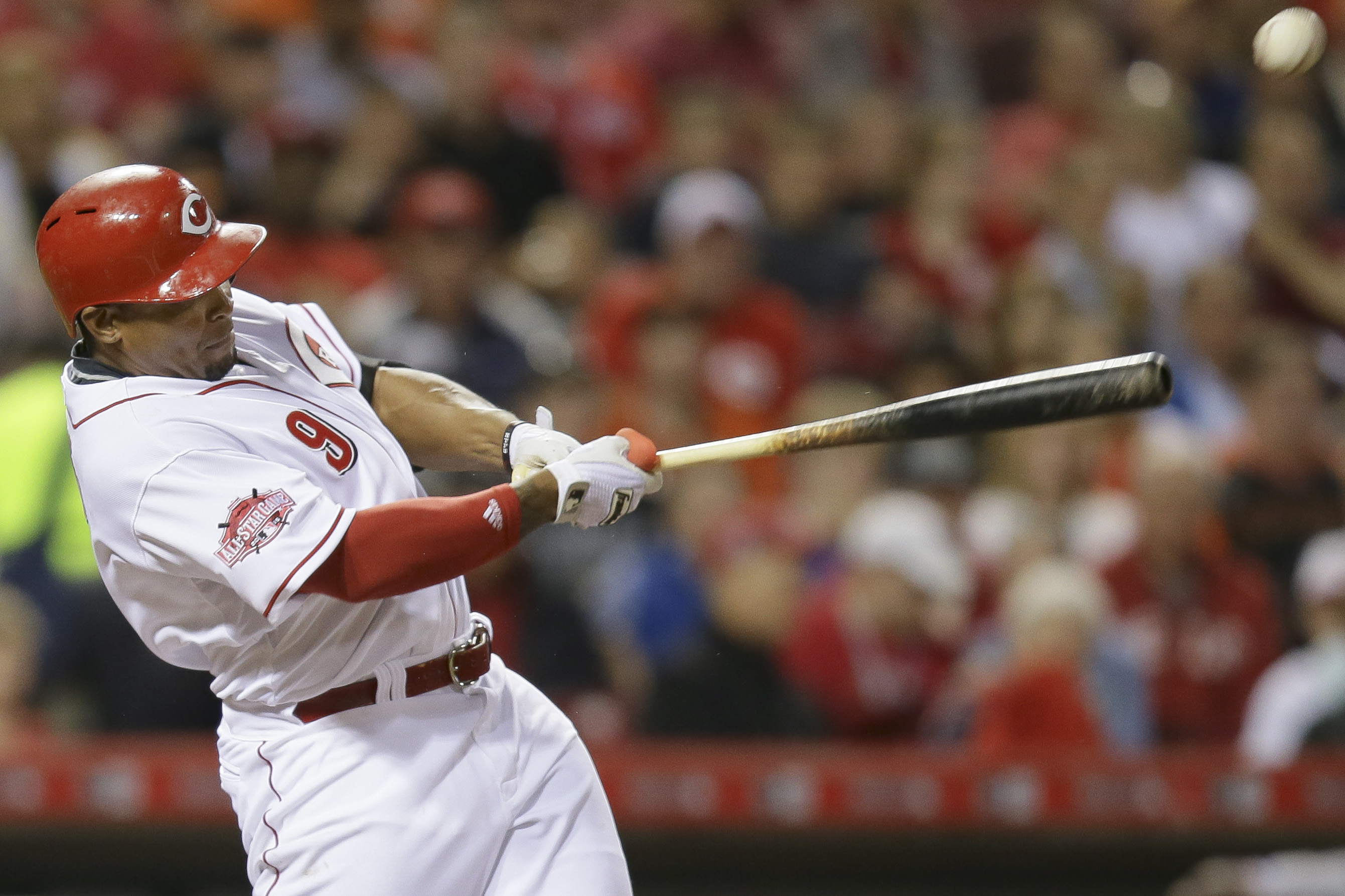 Cincinnati Reds Marlon Byrd hits a single to drive home Johnny Cueto and Zack Cozart in the fifth inning of a baseball game against the San Francisco Giants, Thursday, May 14, 2015, in Cincinnati. (AP Photo/John Minchillo)